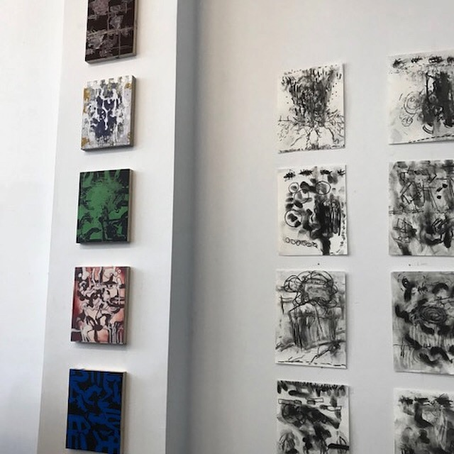 Some of Larry Silver's drawings and paintings hanging side-by-side in his studio.