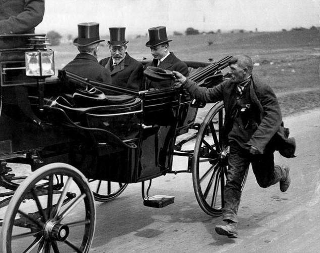 Beggar-running-alongside-a-horse-and-carriage.jpg