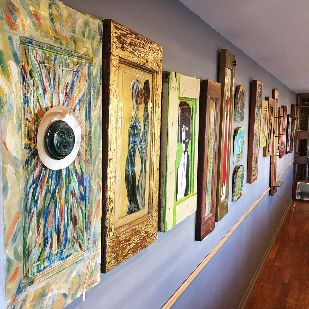 The Art - Gary Mead, Sr. sees opportunity. It is what made him an entrepreneur, but it's also what makes him an artist. All over the Green Door Café you see lively, colorful, rustically framed artworks. Gary's mediums are salvaged wooden doors. For Gary, a door panel presents a canvas with a ready frame. His subjects range from figures to landscapes, from creatures to boats and beyond. Some of the artwork is available for sale, so if it catches your fancy, feel free to inquire.