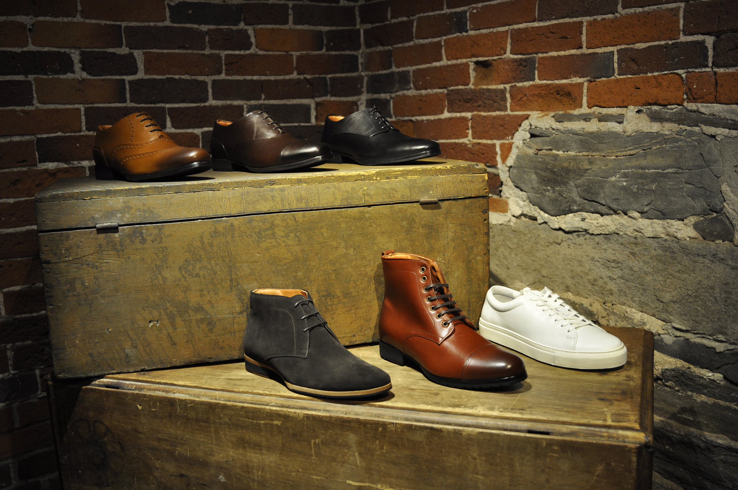 From Top Left clockwise: The  Senna Wingtip ; The  Closer Captoe ; The  Barrister Derby ; The  Glider Cupsole Sneaker ; The  Breakaway Ankle Boot ; The  Striker Chukka