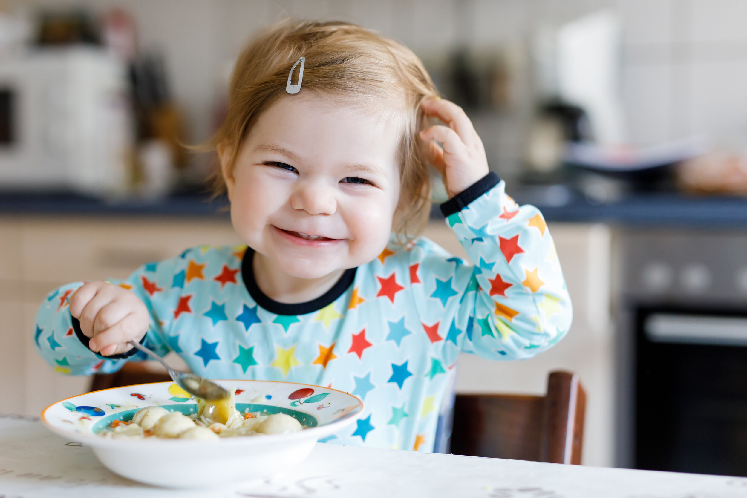 bigstock-Adorable-Baby-Girl-Eating-From-233381668.jpg