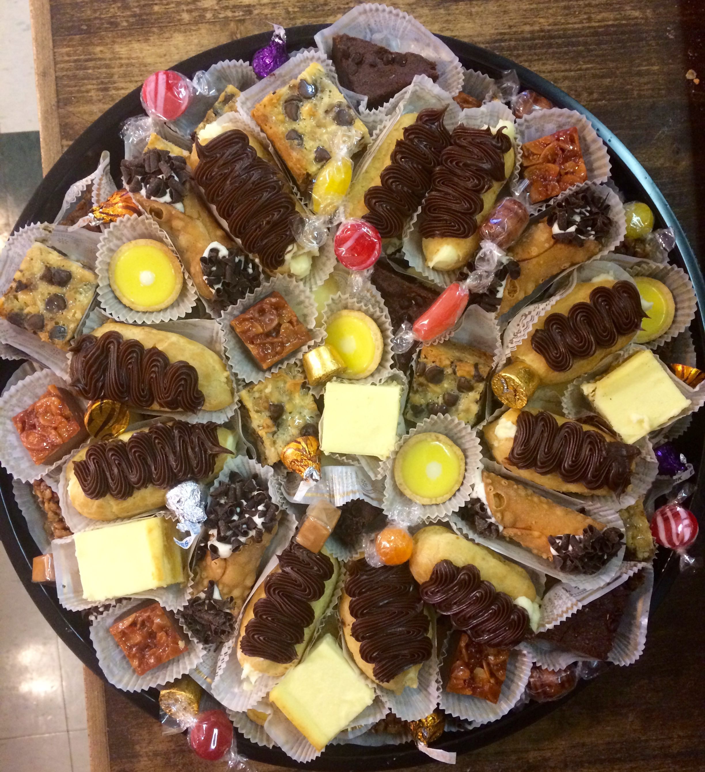 Fancy Sweet Tray - This beautiful tray includes mini cannolis, mini eclairs, brownie diamonds, cheesecake squares, hello dollies, raspberry crumble bars, lemon tarts and small chocolate delightsSmall ~ Serves 15 (40 pieces) ~ $51.50Large ~ Serves 30 (80 pieces) ~ $99.00