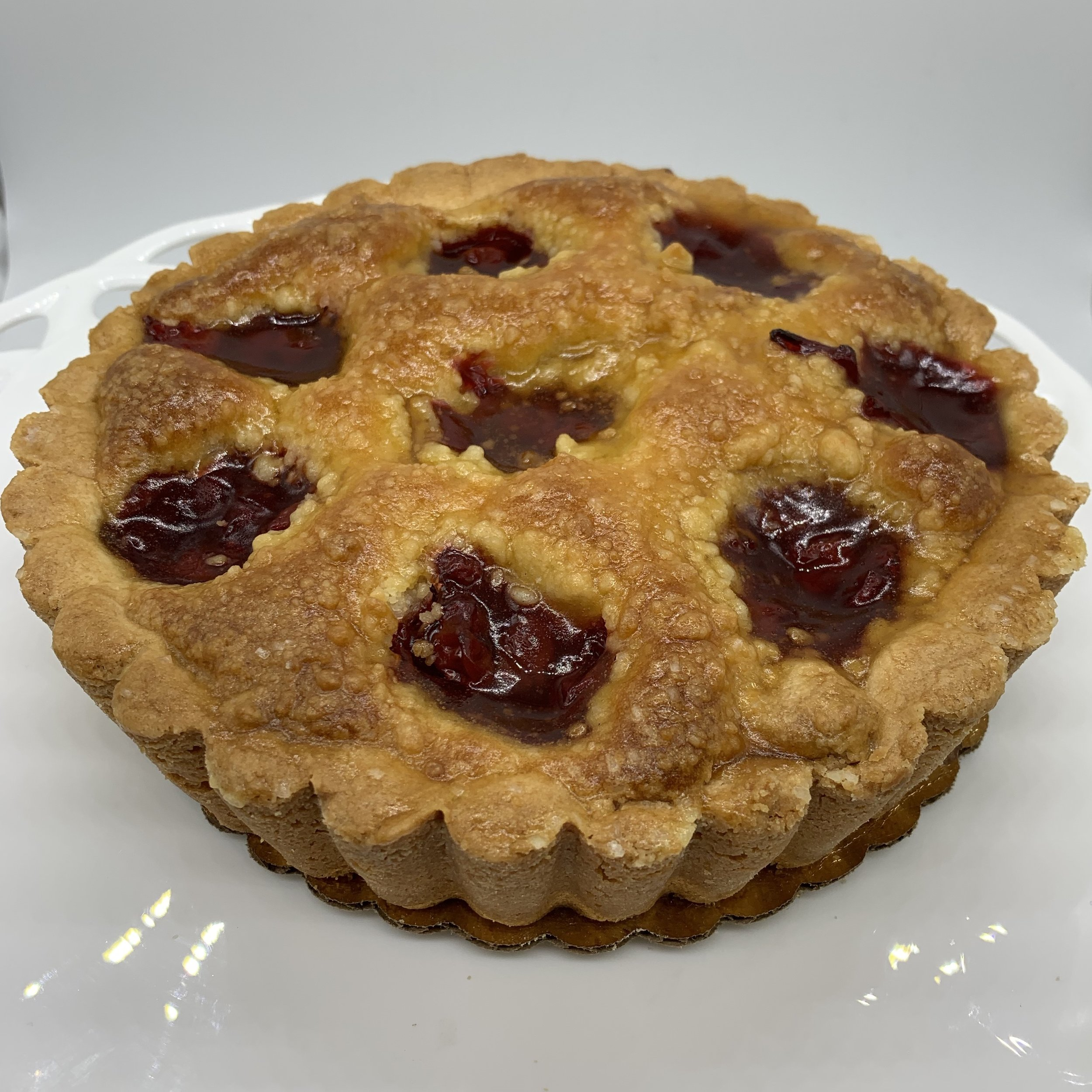 Cherry Flan - A sweet short dough crust layered with cream cheese, cream cake and topped with cherry and streusel.