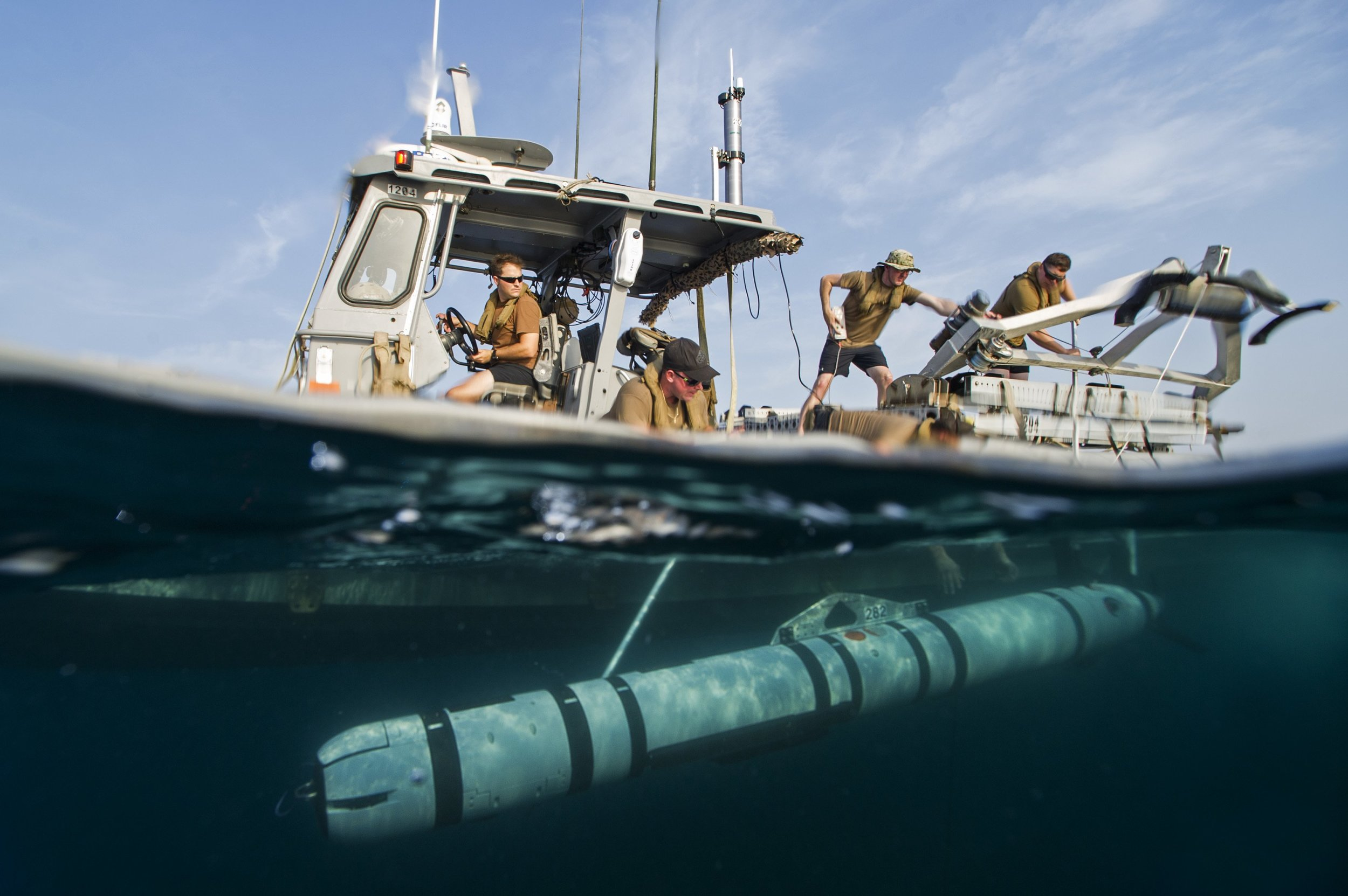 Crew members from Task Group 56.1 launch a MK 18 MOD 2 unmanned underwater vehicle from a rigid-hull inflatable boat during Squadex 2016, on Aug. 2, 2016, in the Persian Gulf. Squadex 2016 demonstrates U.S./U.K. mine detection capabilities in the U.S. 5th Fleet area of operations. US Navy photo.