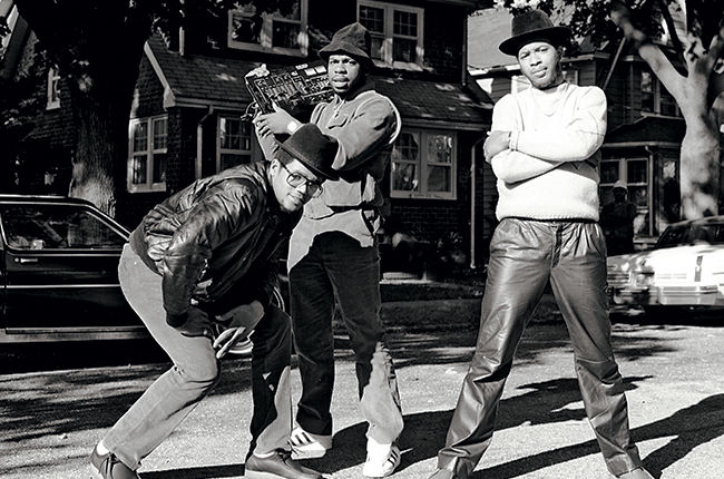 This shows RUN-D.M.C. in 1983 before they all started rocking Adidas sneakers