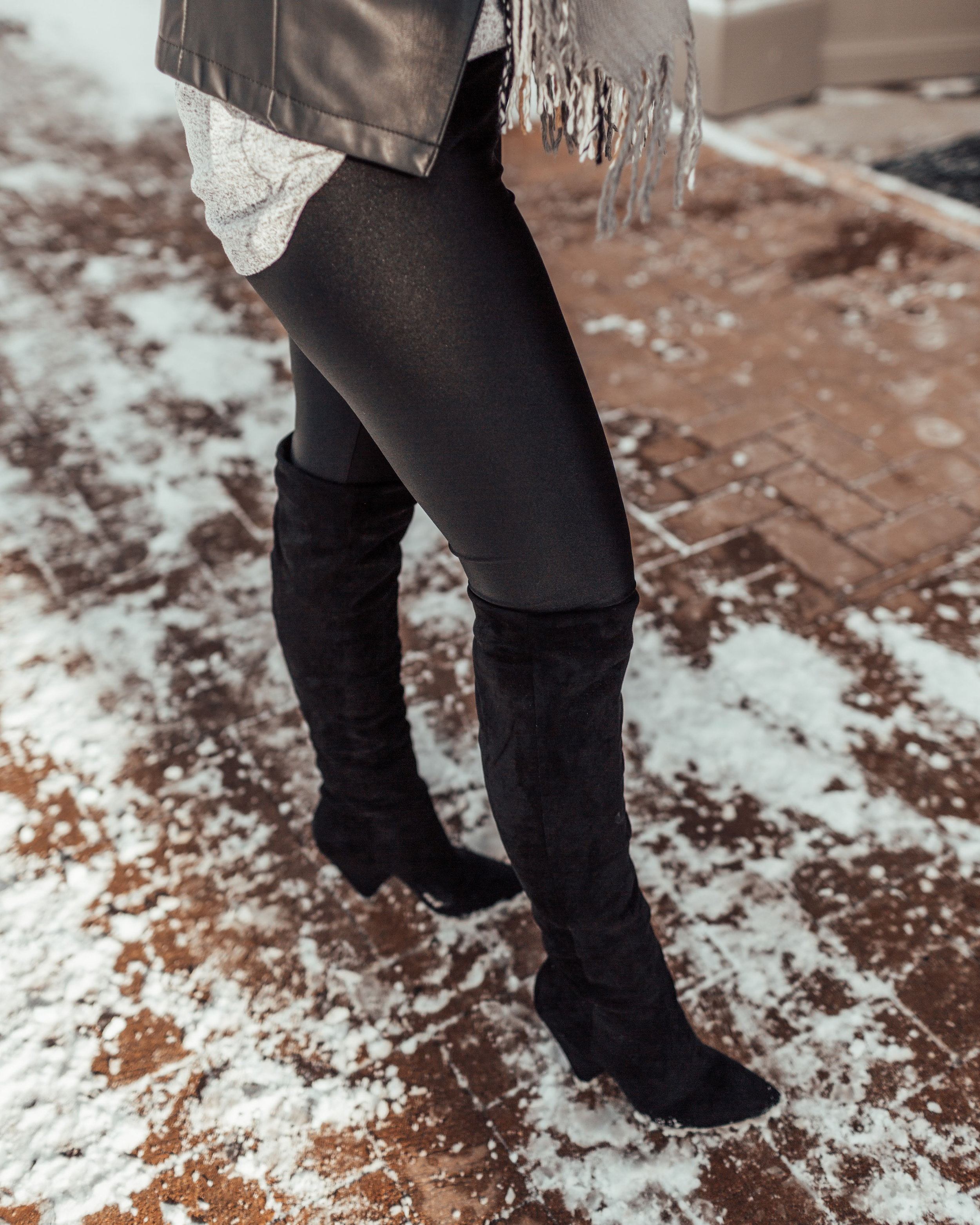 My black shiny leggings paired with my slouchy to the knee boots!