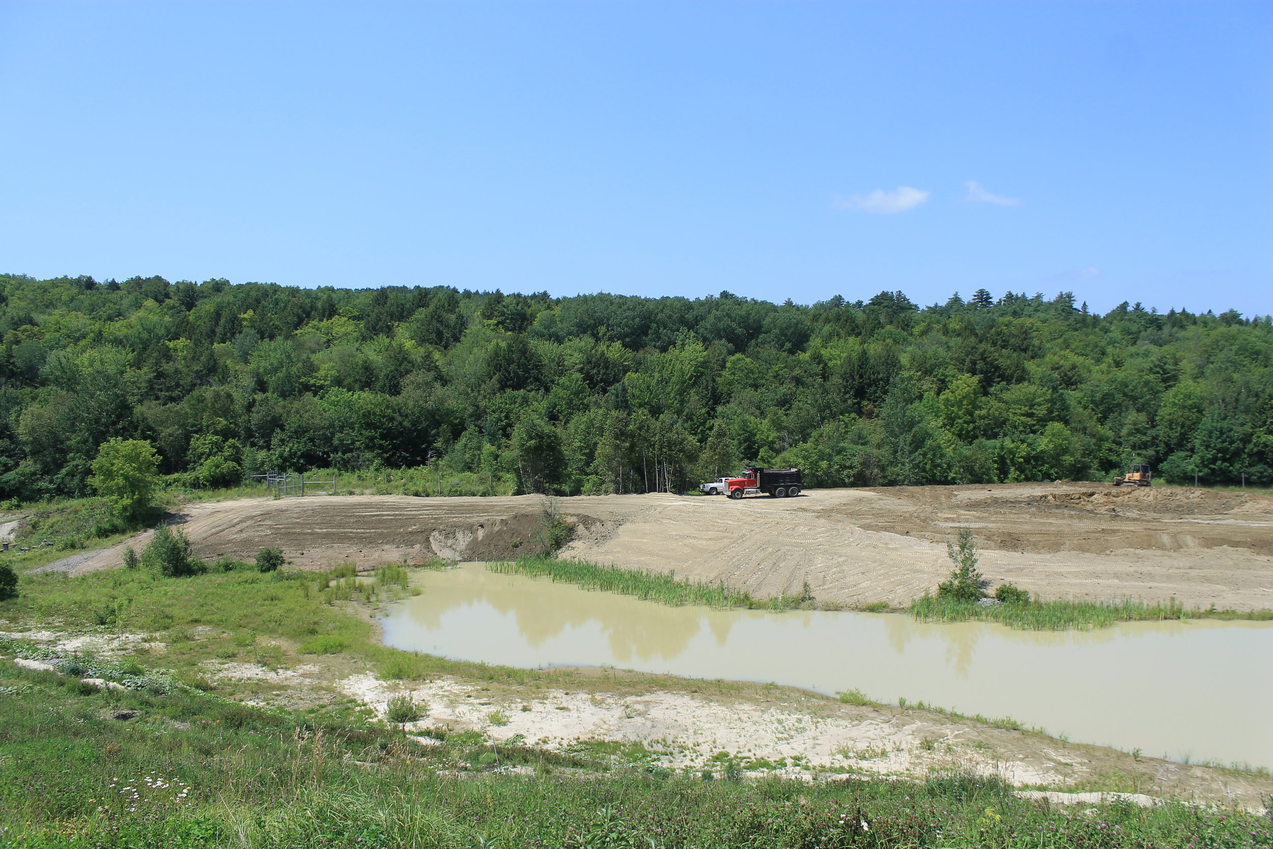 Dennis and Cliffy flattened the area beyond the pond and cut in an access road this summer