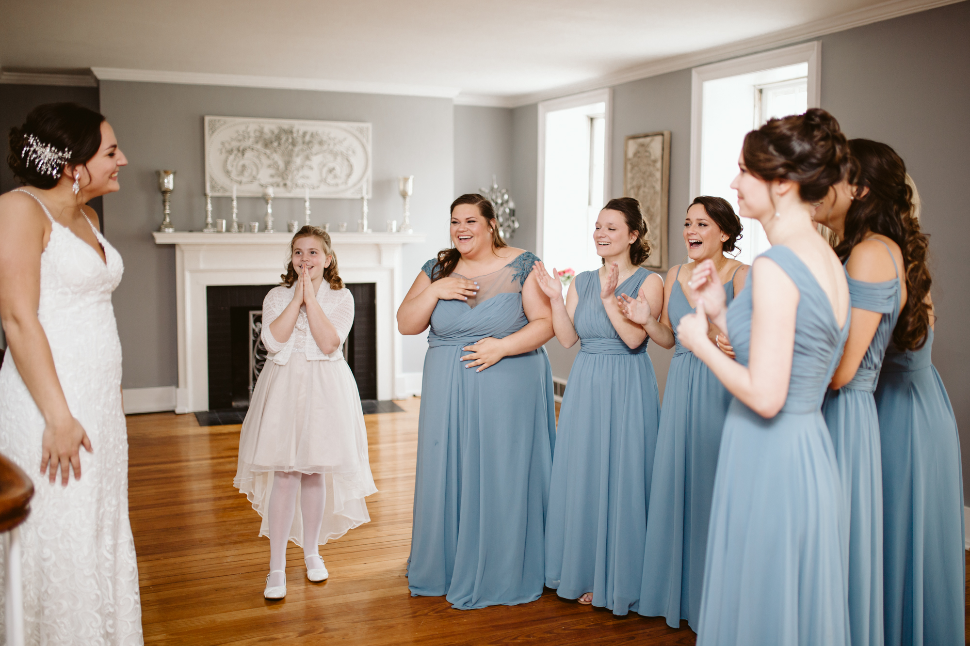 Bridesmaids reveal at stone house of st charles wedding