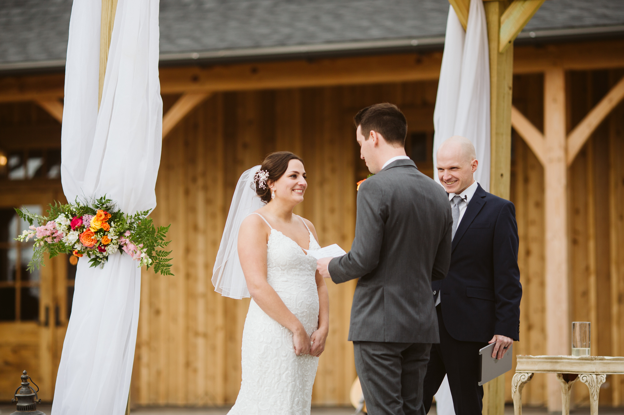 Groom saying his vows at stone house of saint charles in missouri