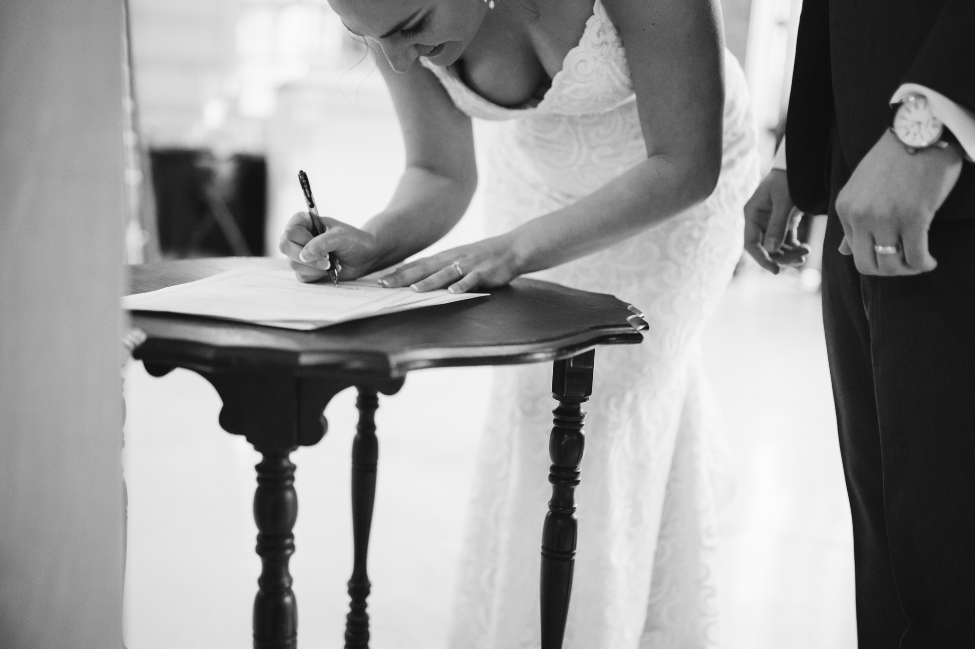 Signing the marriage license at a stone house of st charles wedding in missouri