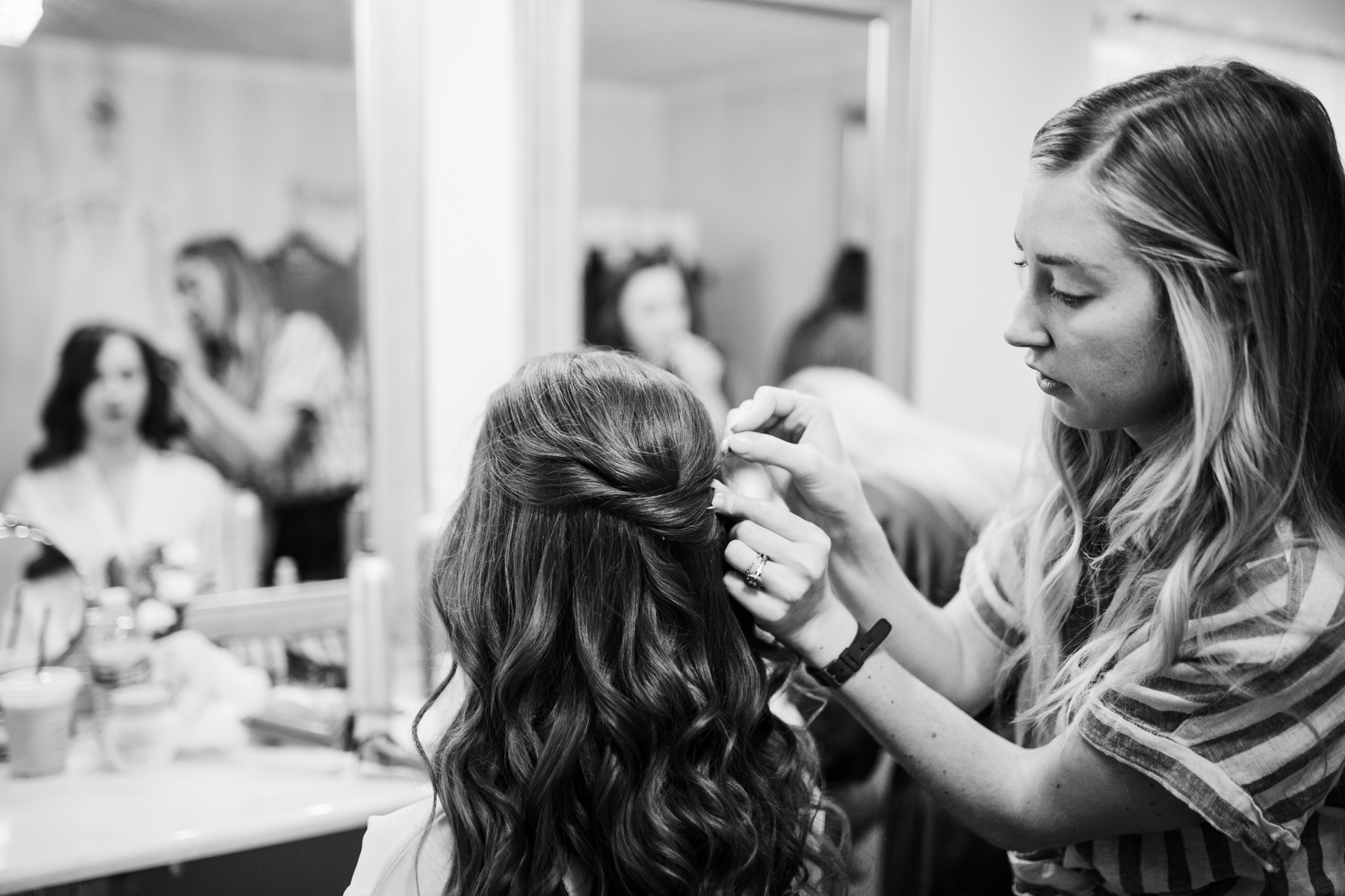 Bride getting her hair done before a A Rustic Wedding at Barn in the Bend in Nashville, Tennessee