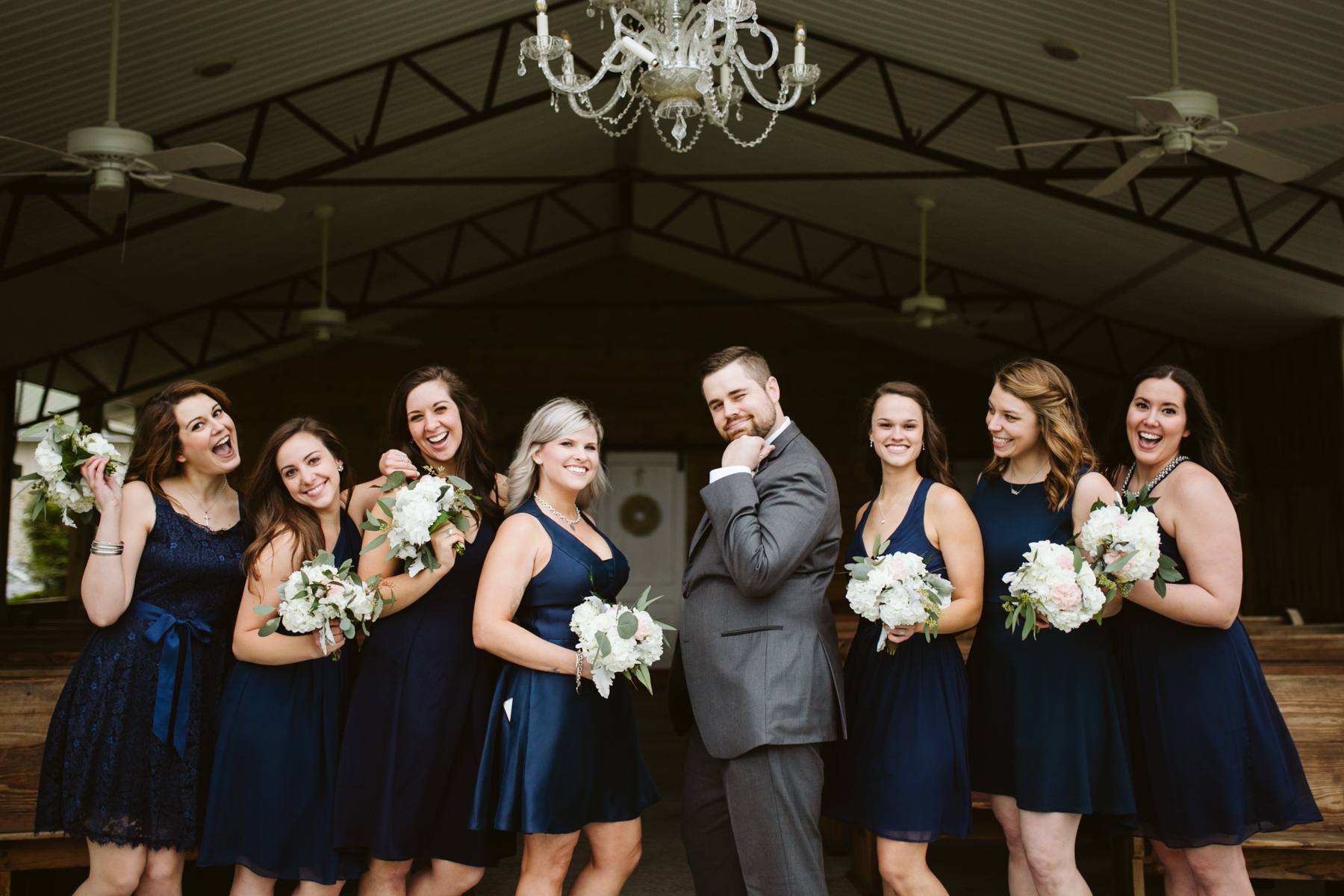 Groom with the bridesmaids before A Rustic Wedding at Barn in the Bend in Nashville, Tennessee