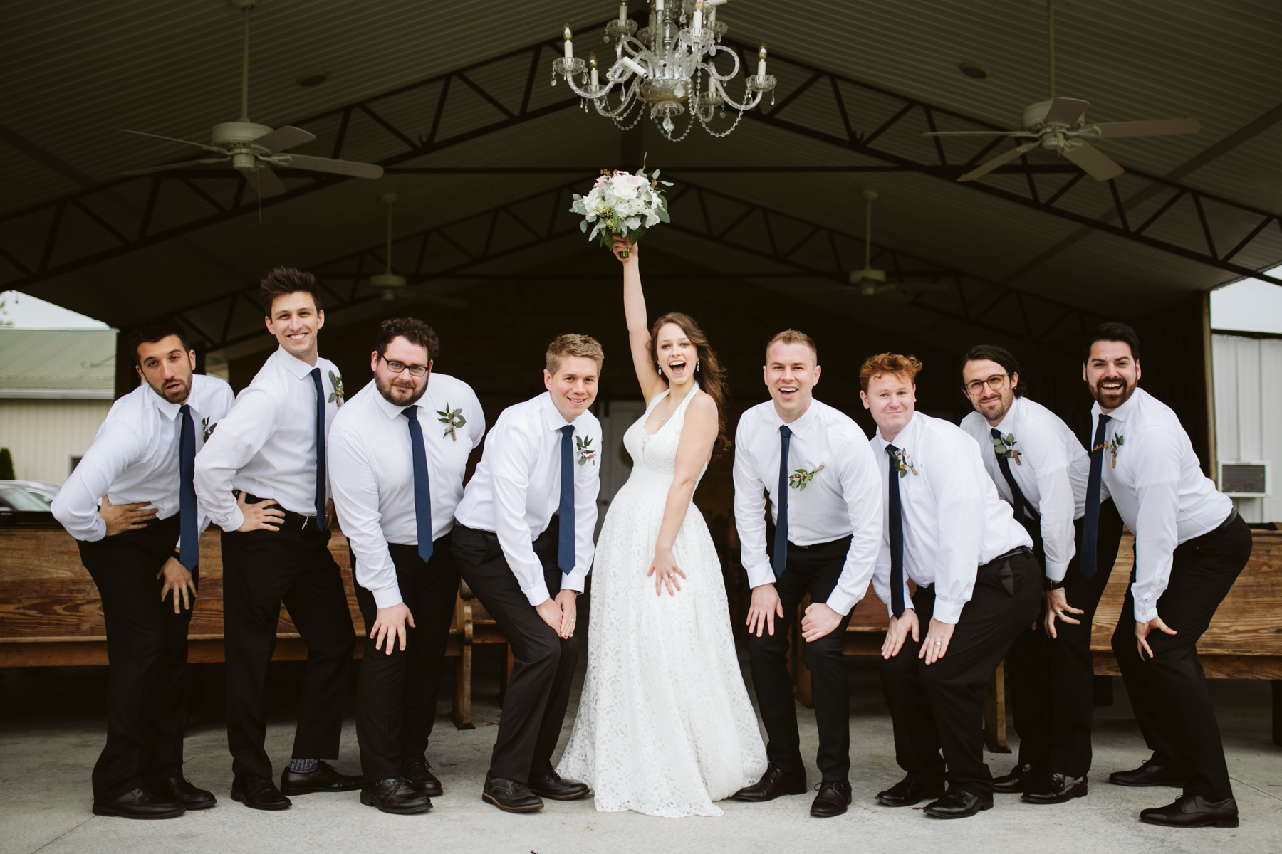 Bride with the groomsmen before A Rustic Wedding at Barn in the Bend in Nashville, Tennessee