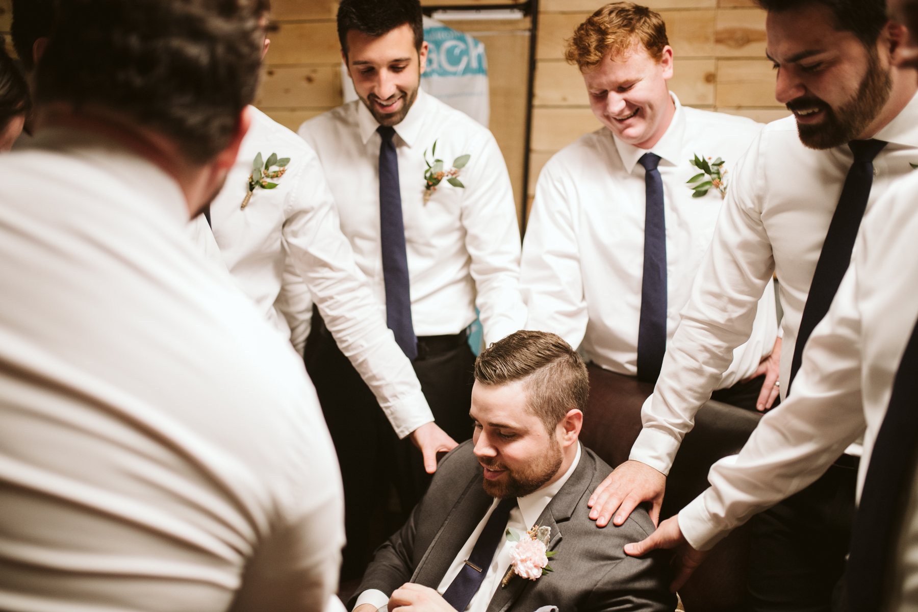 Groomsmen praying over the groom before A Rustic Wedding at Barn in the Bend in Nashville, Tennessee