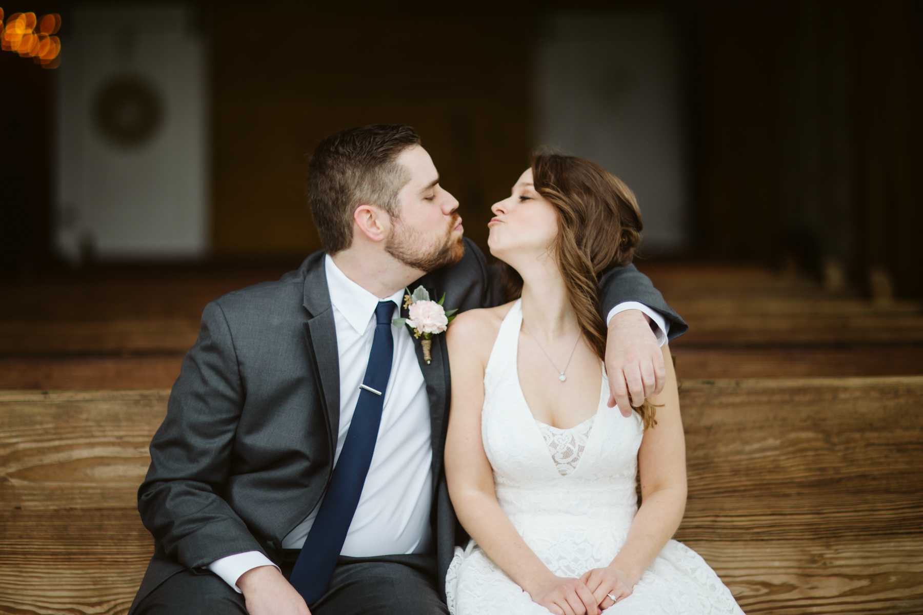 Bride and groom portraits on a pew at a A Rustic Wedding at Barn in the Bend in Nashville, Tennessee