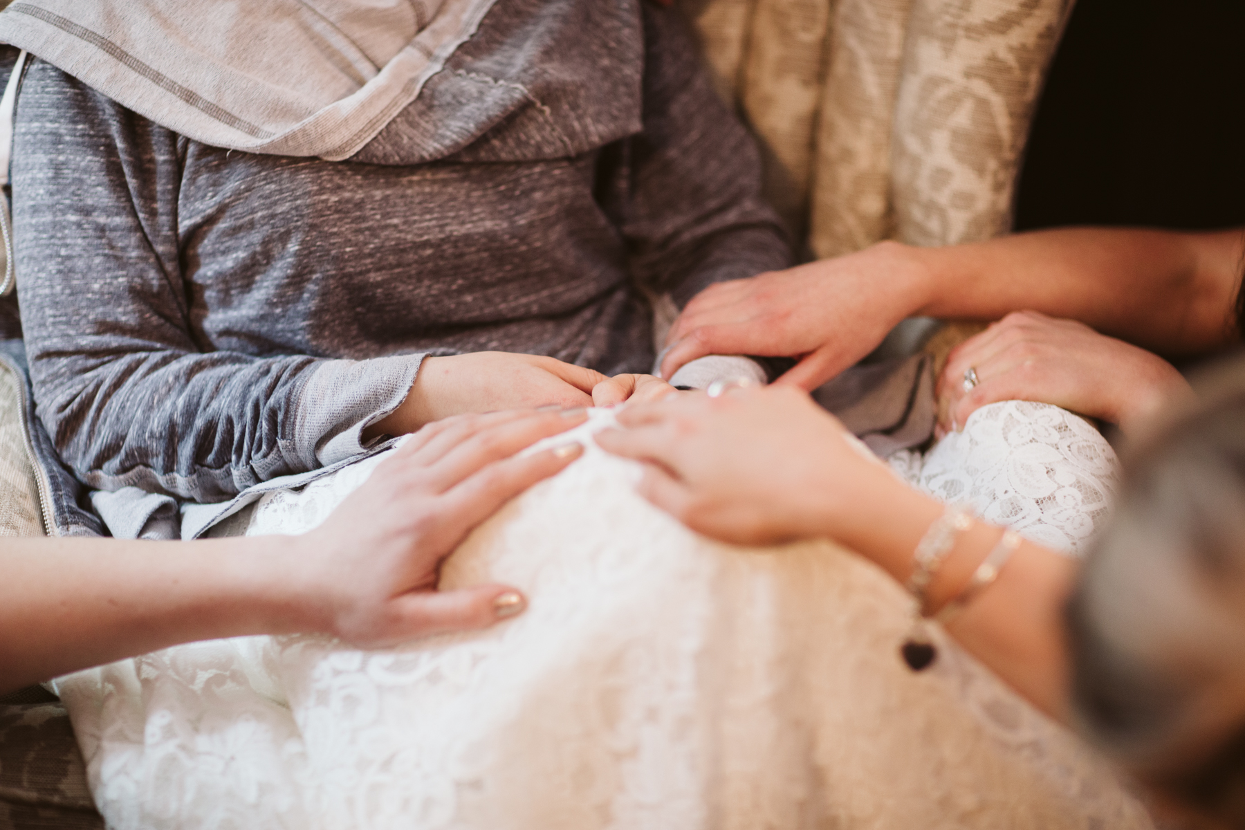Bridesmaids praying over the bride before A Rustic Wedding at Barn in the Bend in Nashville, Tennessee