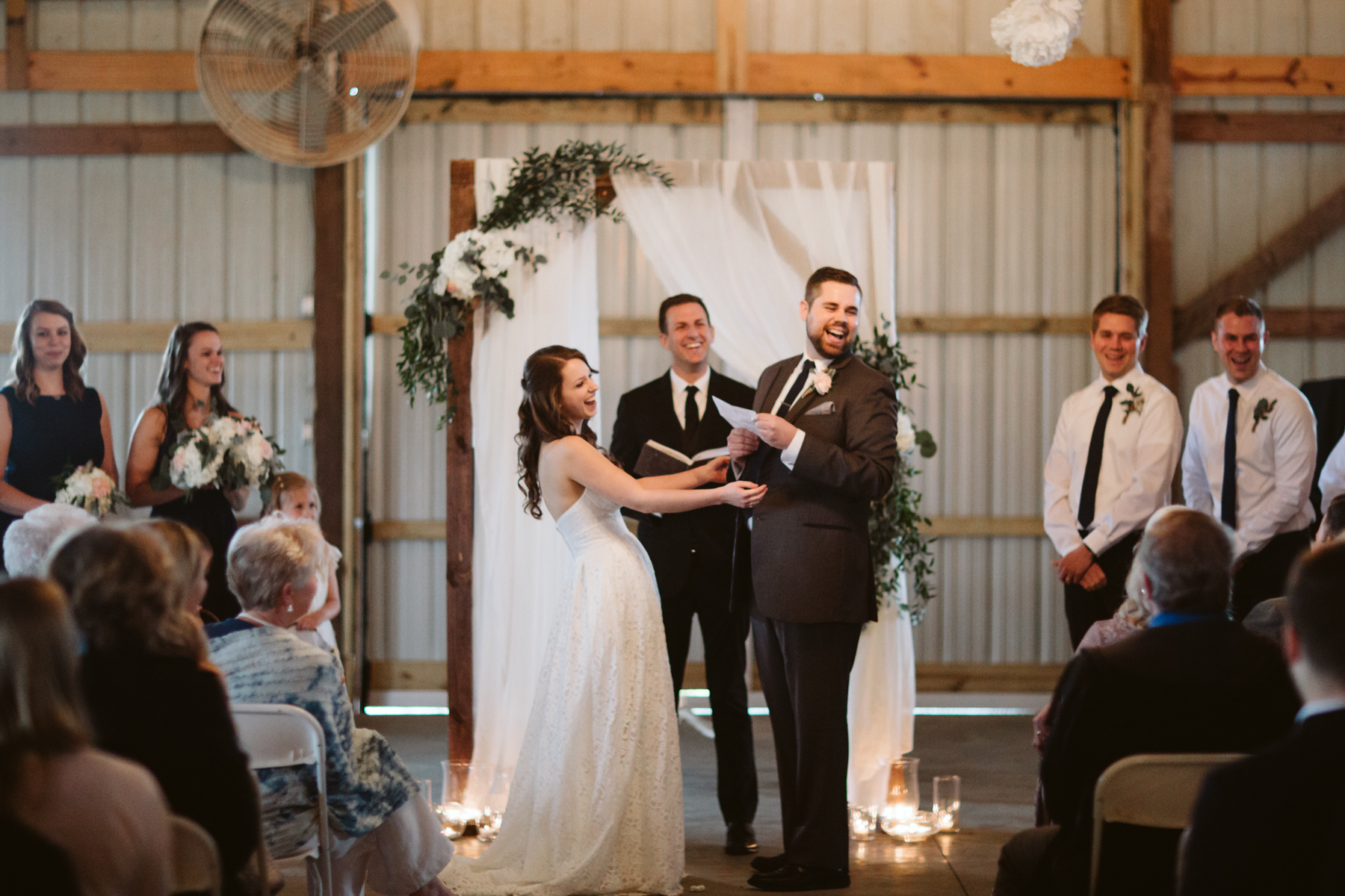 Bride and groom sharing vows at A Rustic Wedding at Barn in the Bend in Nashville, Tennessee