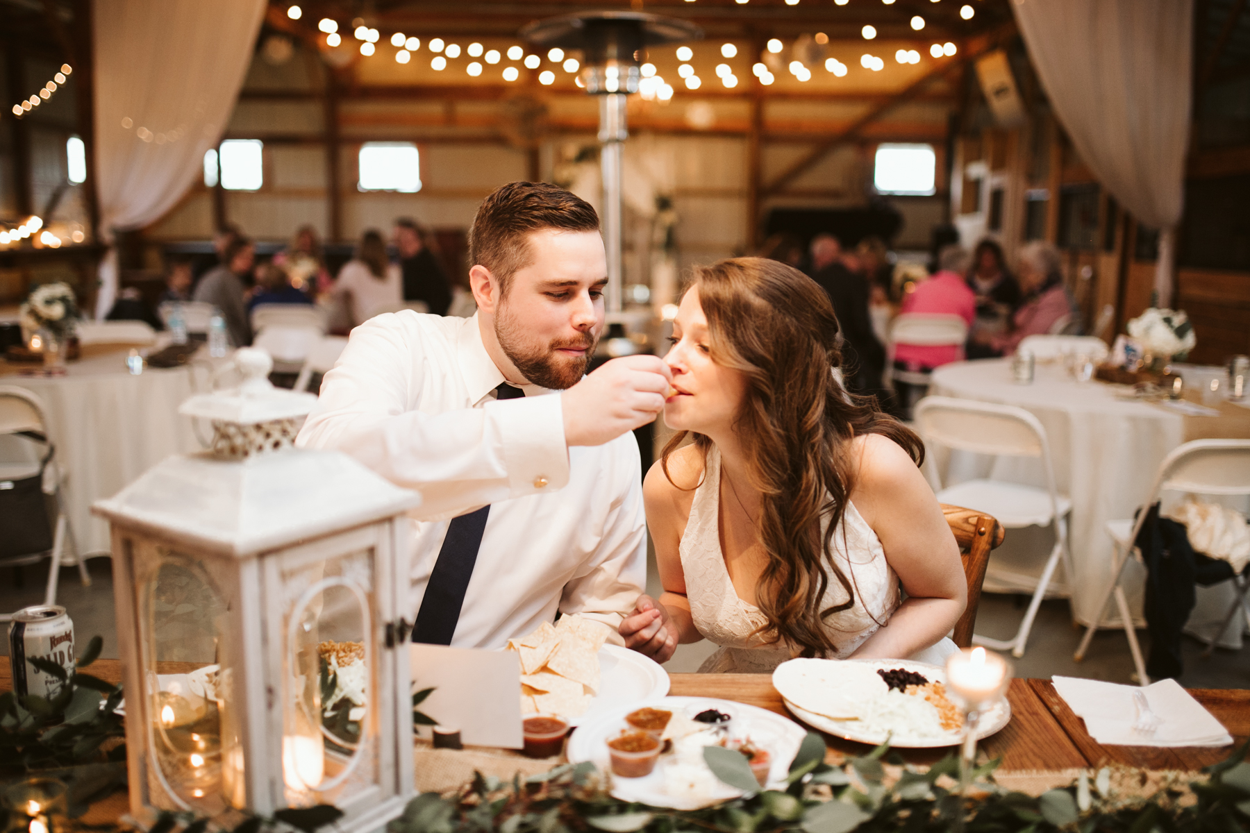 Bride and groom's first meal after A Rustic Wedding at Barn in the Bend in Nashville, Tennessee