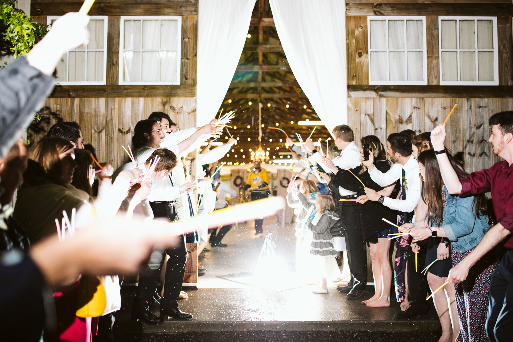 Glow stick exit after a rustic wedding at Barn in the Bend in Nashville, Tennessee