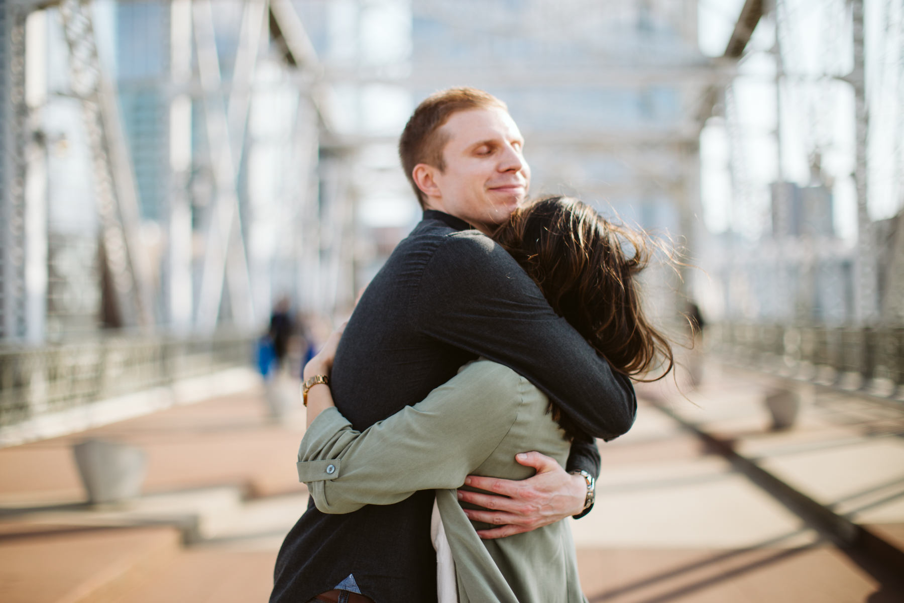 Sunny engagement session on the pedestrian bridge in downtown Nashville, Tennessee