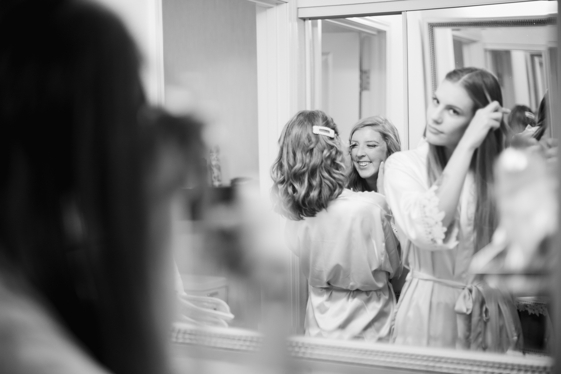 girls getting ready before a rainy summer wedding at brentwood hills church in Nashville, tennessee