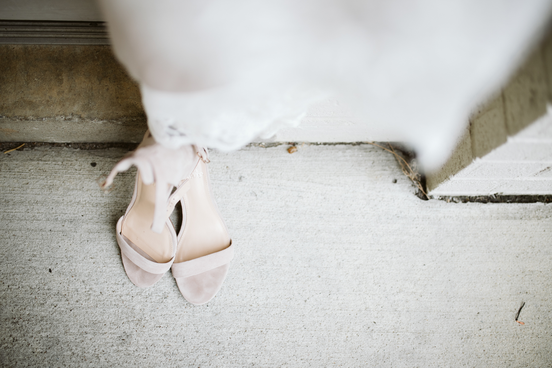 Wedding dress and shoes displayed at a rainy summer wedding at brentwood hills church in Nashville, tennessee