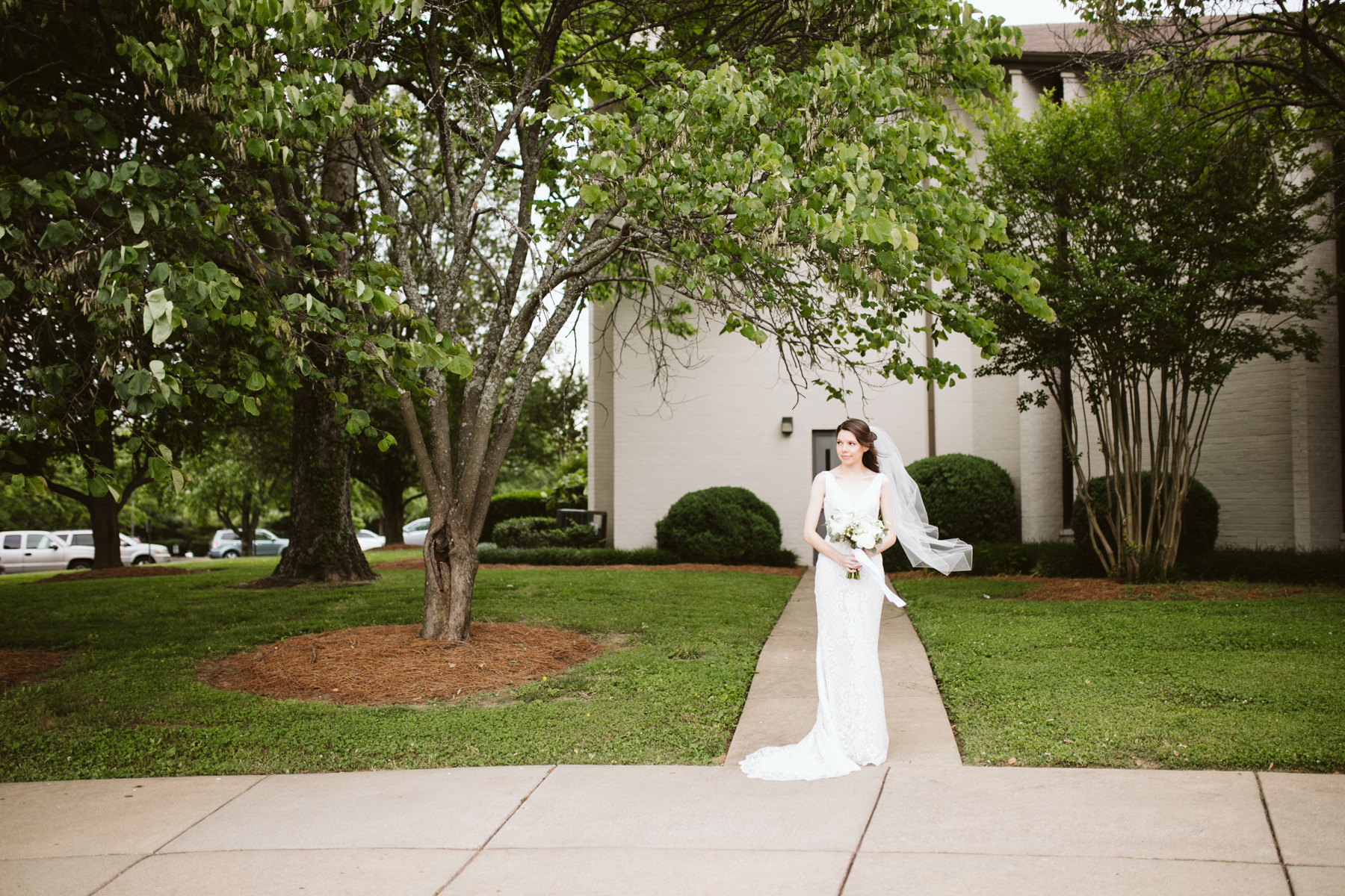 Bridal portraits outside the church before a rainy summer wedding at brentwood hills church in Nashville, tennessee