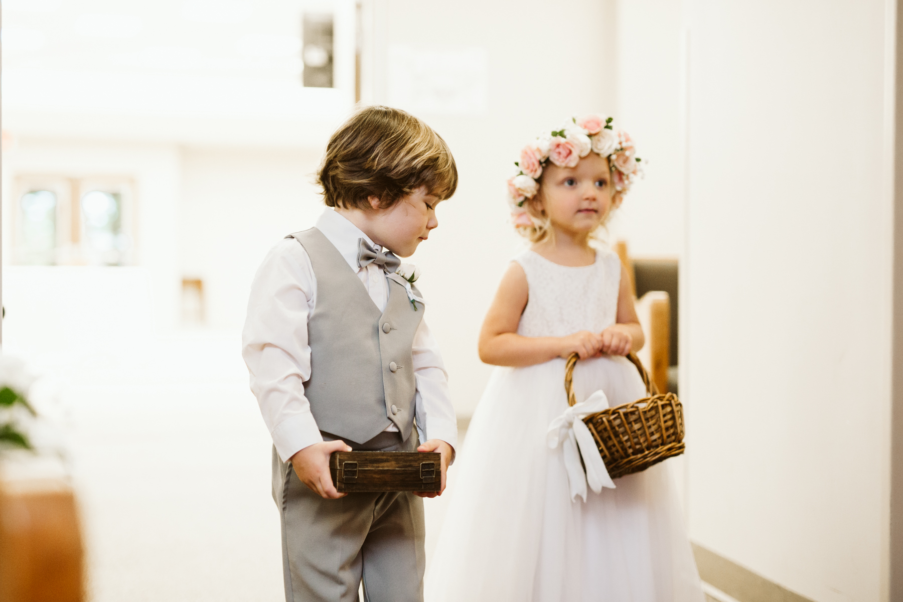ring bearer and flower girl at a rainy summer wedding at brentwood hills church in Nashville, tennessee