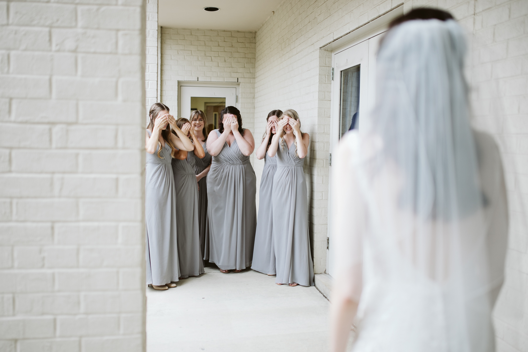 bridesmaid reveal before a rainy summer wedding at brentwood hills church in Nashville, tennessee