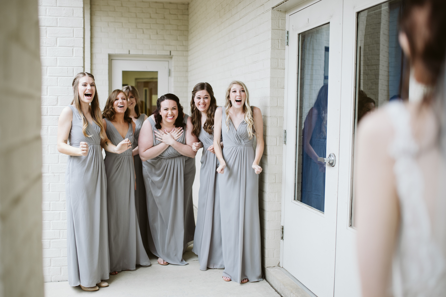 the sweetest bridesmaids reveal before a rainy summer wedding at brentwood hills church in Nashville, tennessee