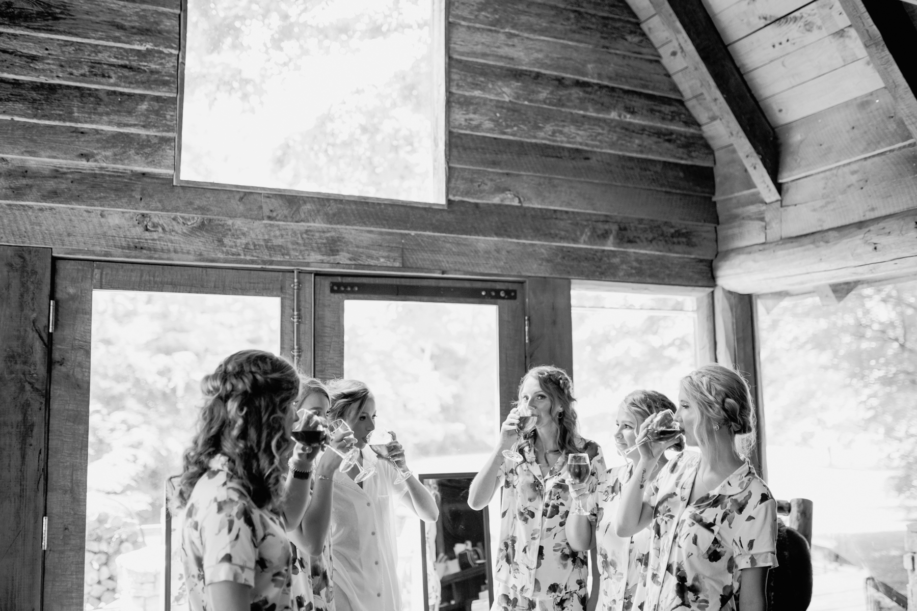 Bridesmaids give a toast before a stables at strawberry creek wedding in Knoxville, tennessee