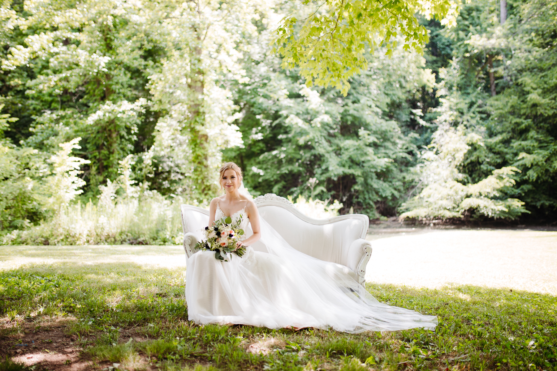 bridal portraits on a gorgeous white couch at a stables at strawberry creek wedding in Knoxville, tennessee