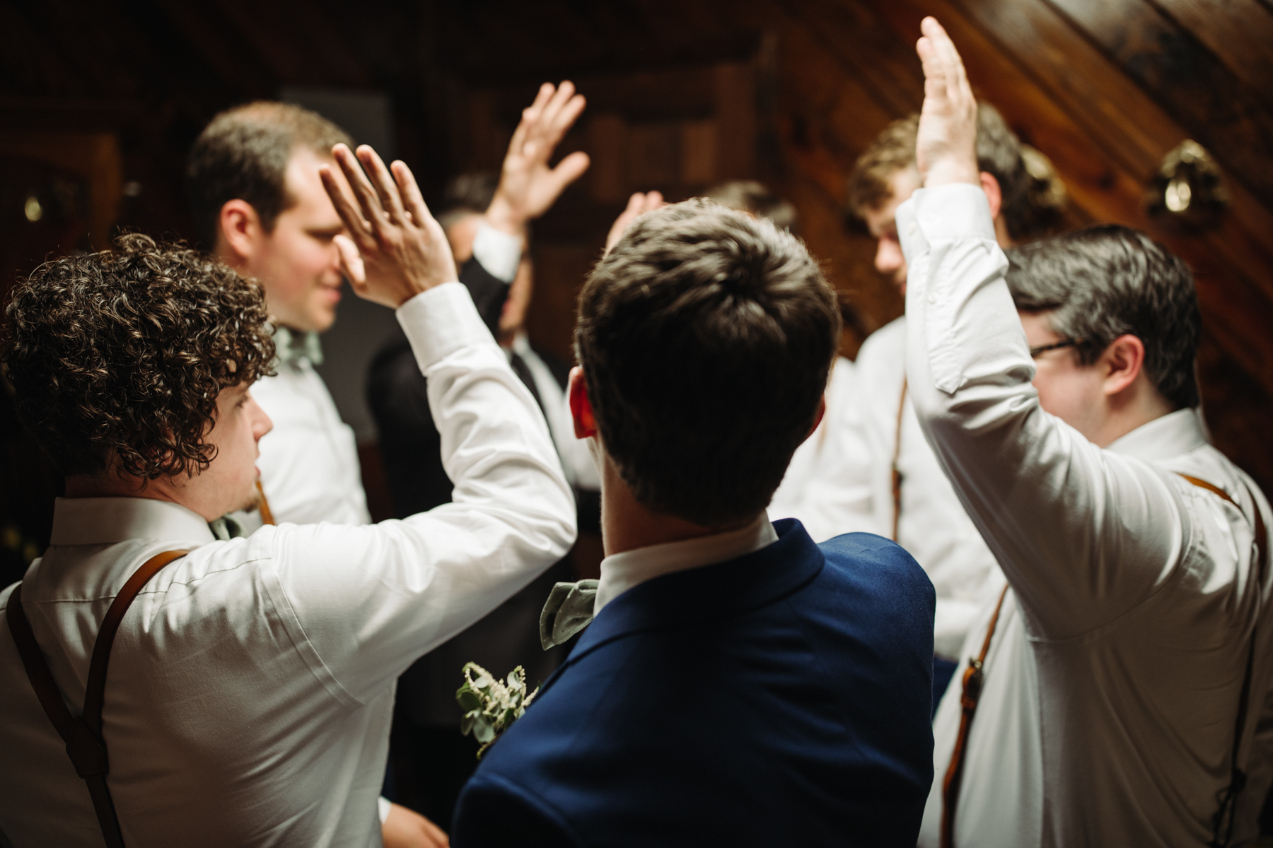 Groomsmen pray and give a cheer before a stables at strawberry creek wedding in Knoxville, tennessee