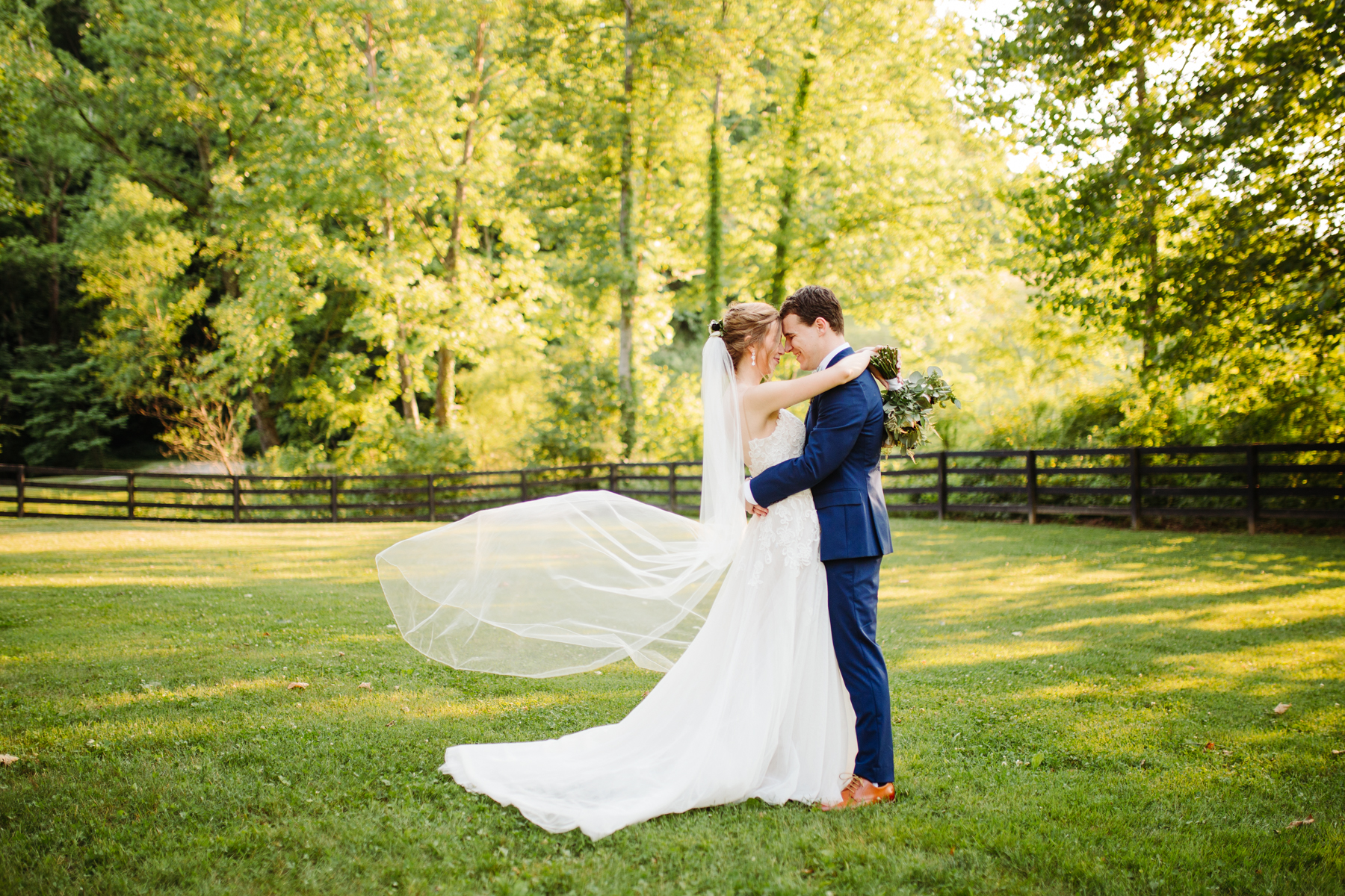 Bridal portraits with a gorgeous veil at a stables at strawberry creek wedding in Knoxville, tennessee