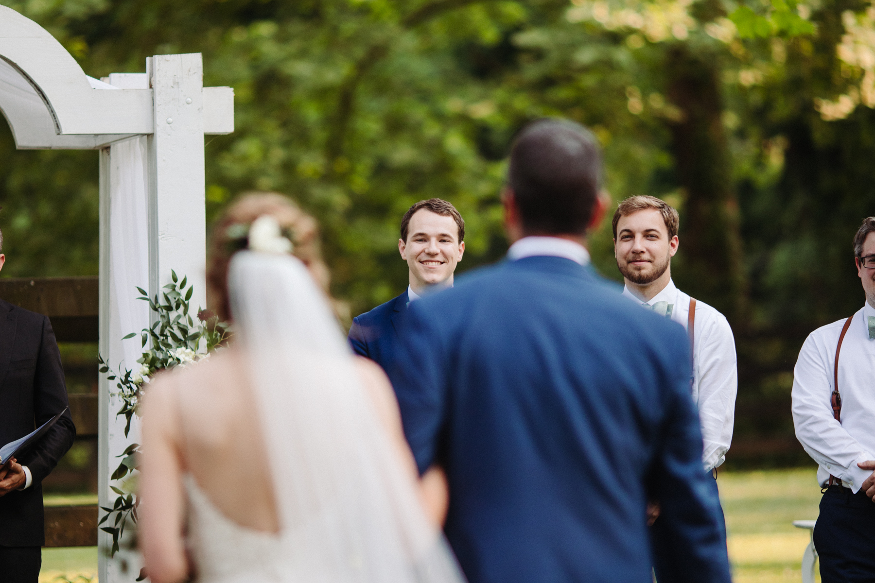 Groom watching his bride come down the aisle at a stables at strawberry creek wedding in knoxville, tennessee