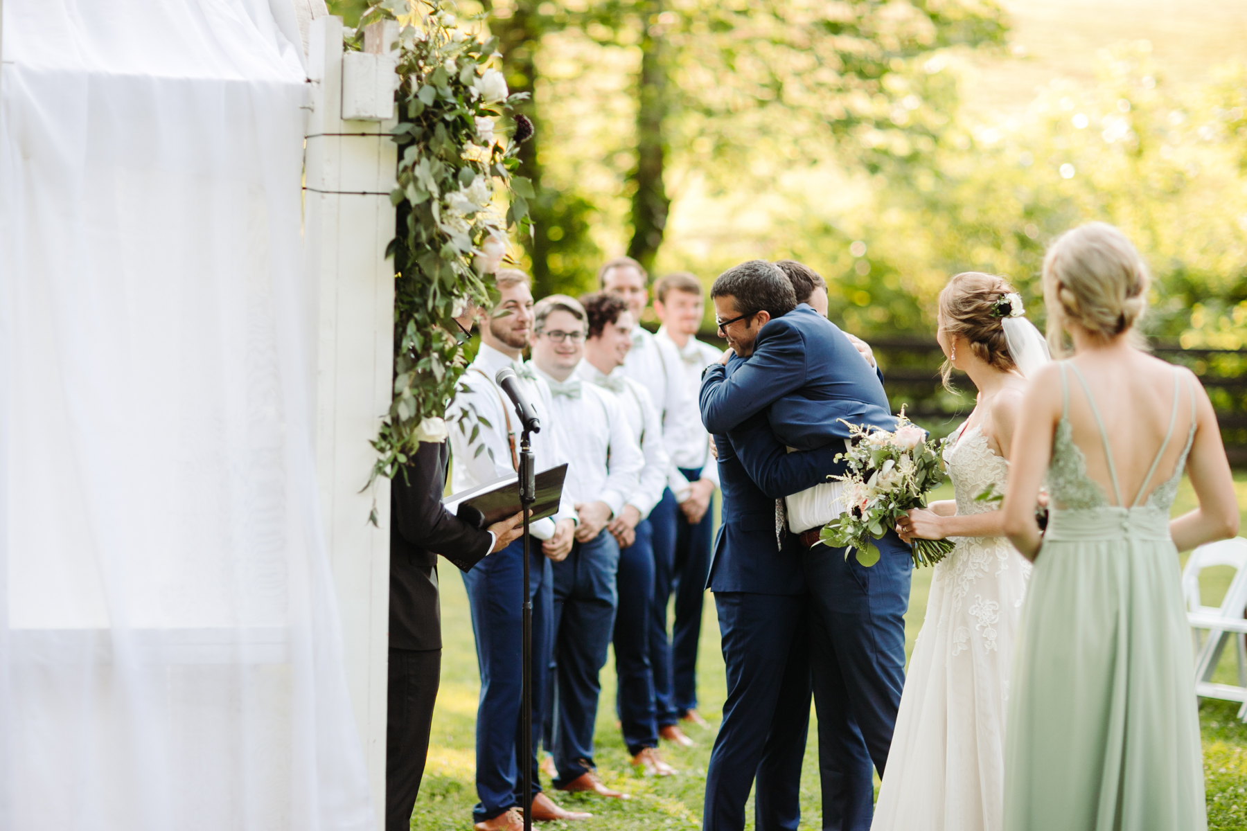 Father hands off his daughter to her groom at a stables at strawberry creek wedding in knoxville, tennessee