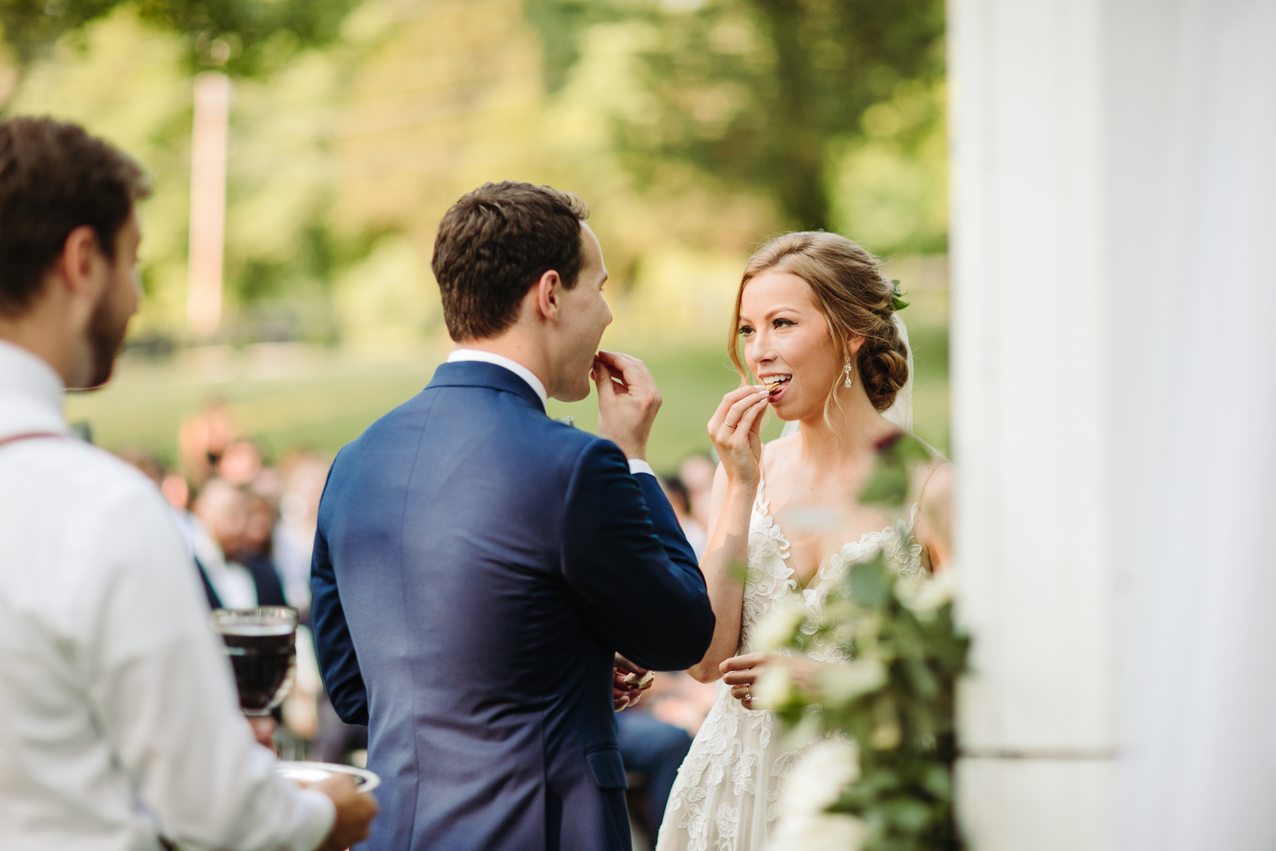 Bride and groom take communion during their stables at strawberry creek wedding in knoxville, tennessee