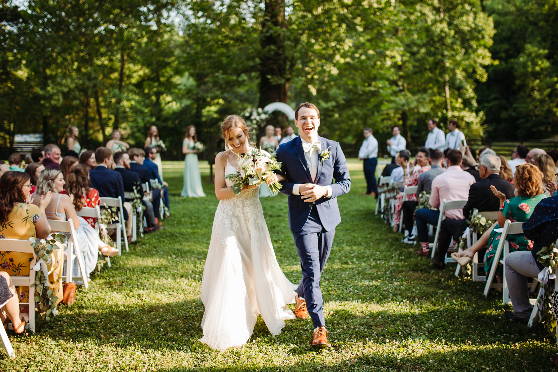 Bride and groom celebrate walking down the aisle at a stables at strawberry creek wedding in knoxville, tennessee