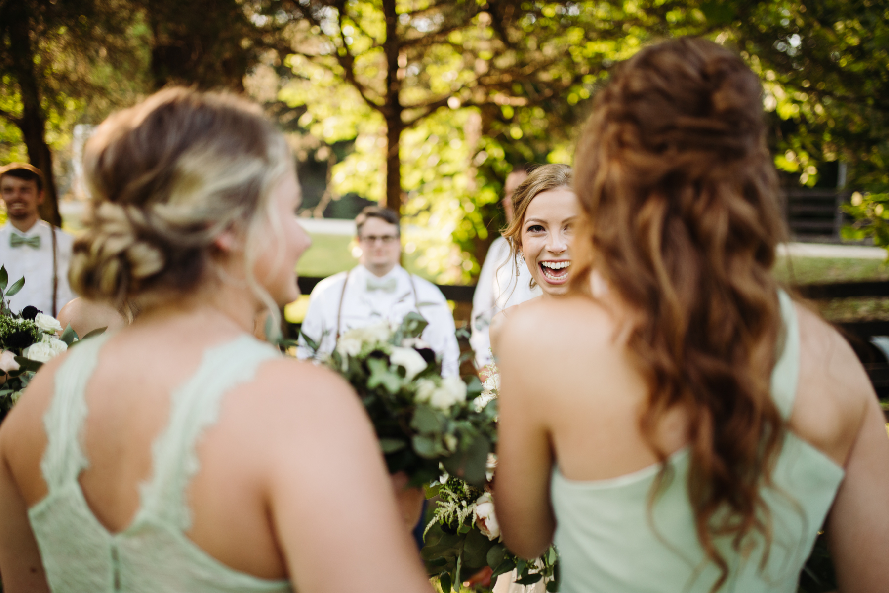 Newly married bride and her bridesmaids after a stables at strawberry creek wedding in knoxville, tennessee