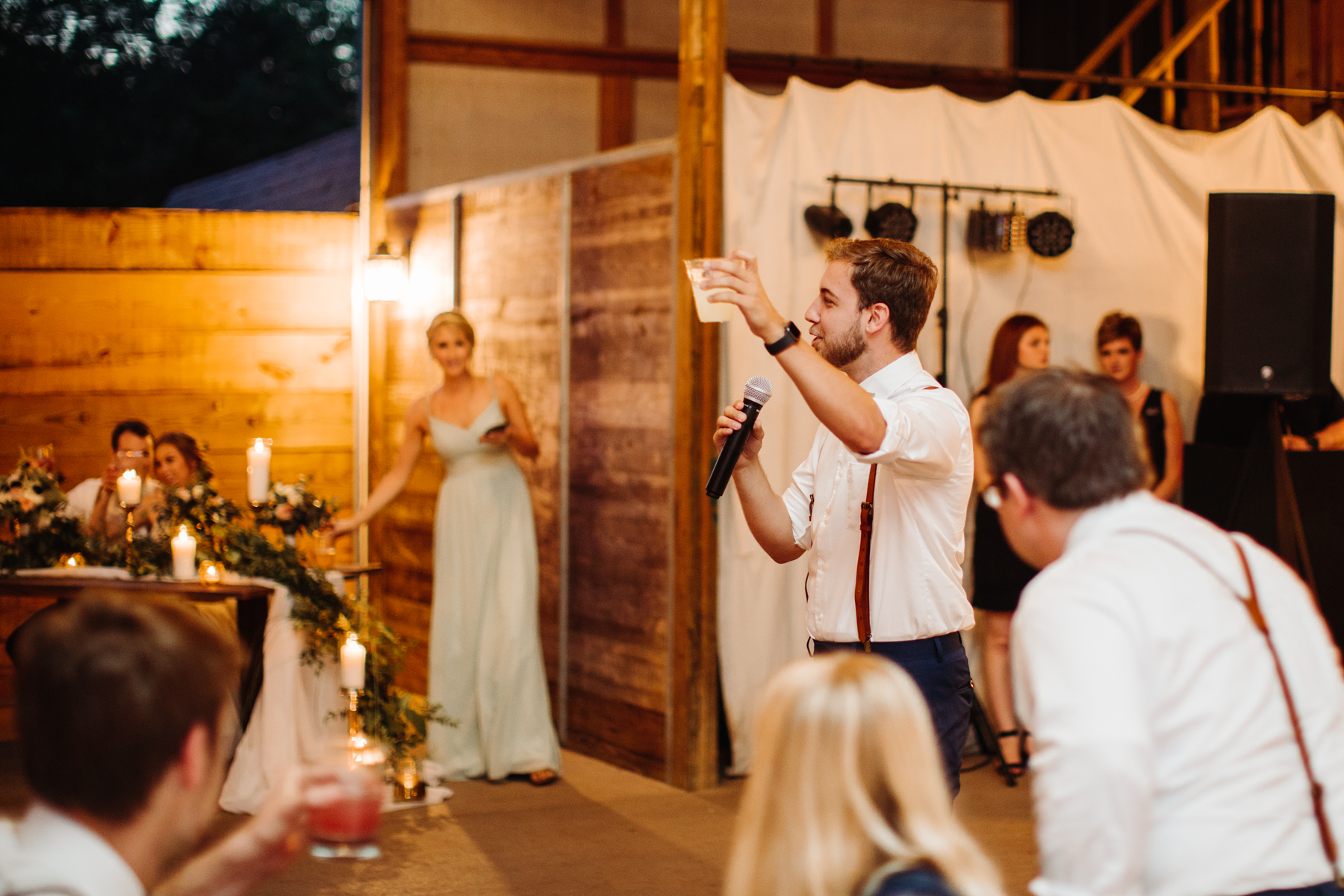 Best man gives a toast at stables at strawberry creek wedding in knoxville, tennessee