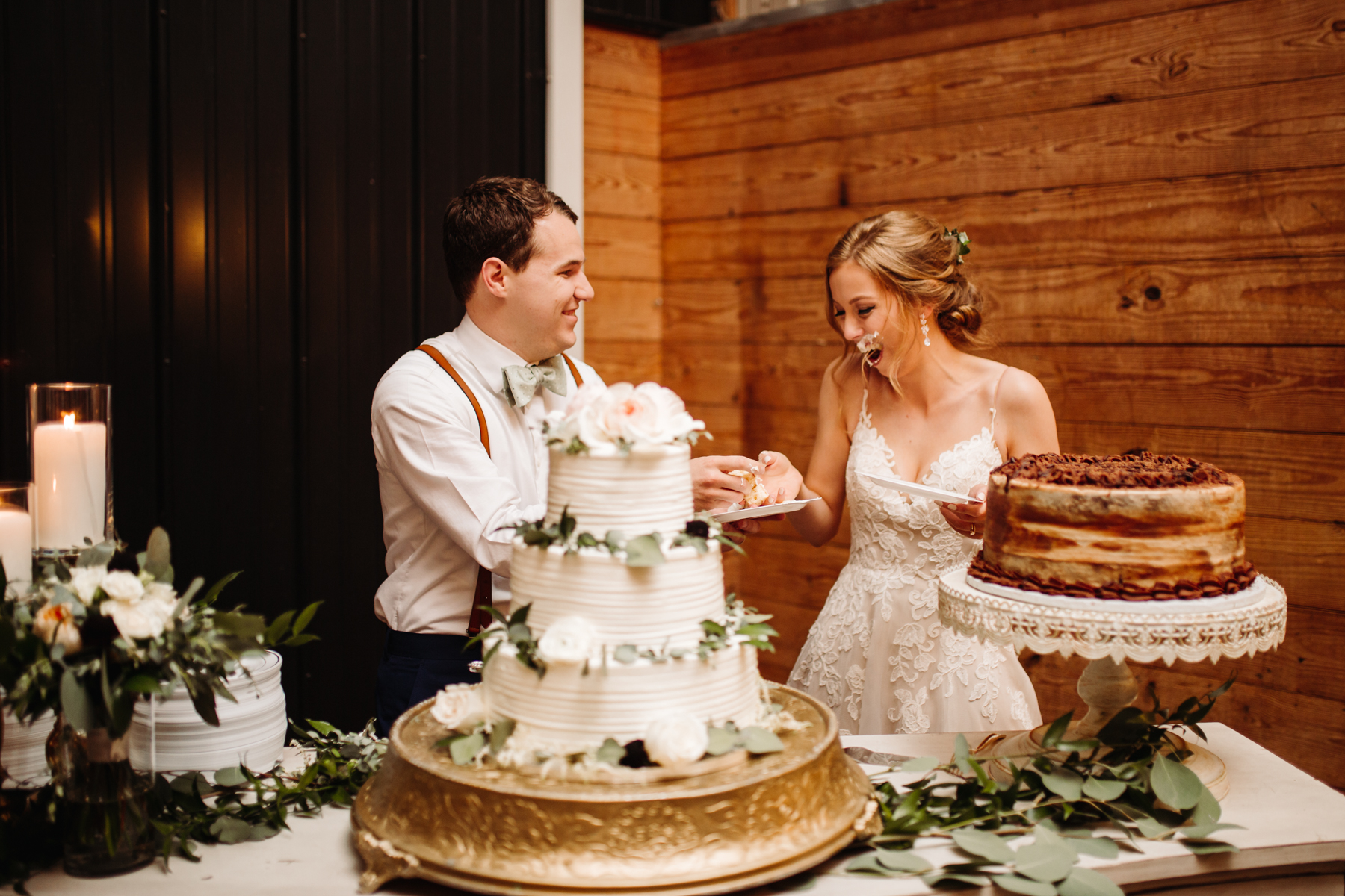 Bride and groom cut the cake at a stables at strawberry creek wedding in knoxville, tennessee