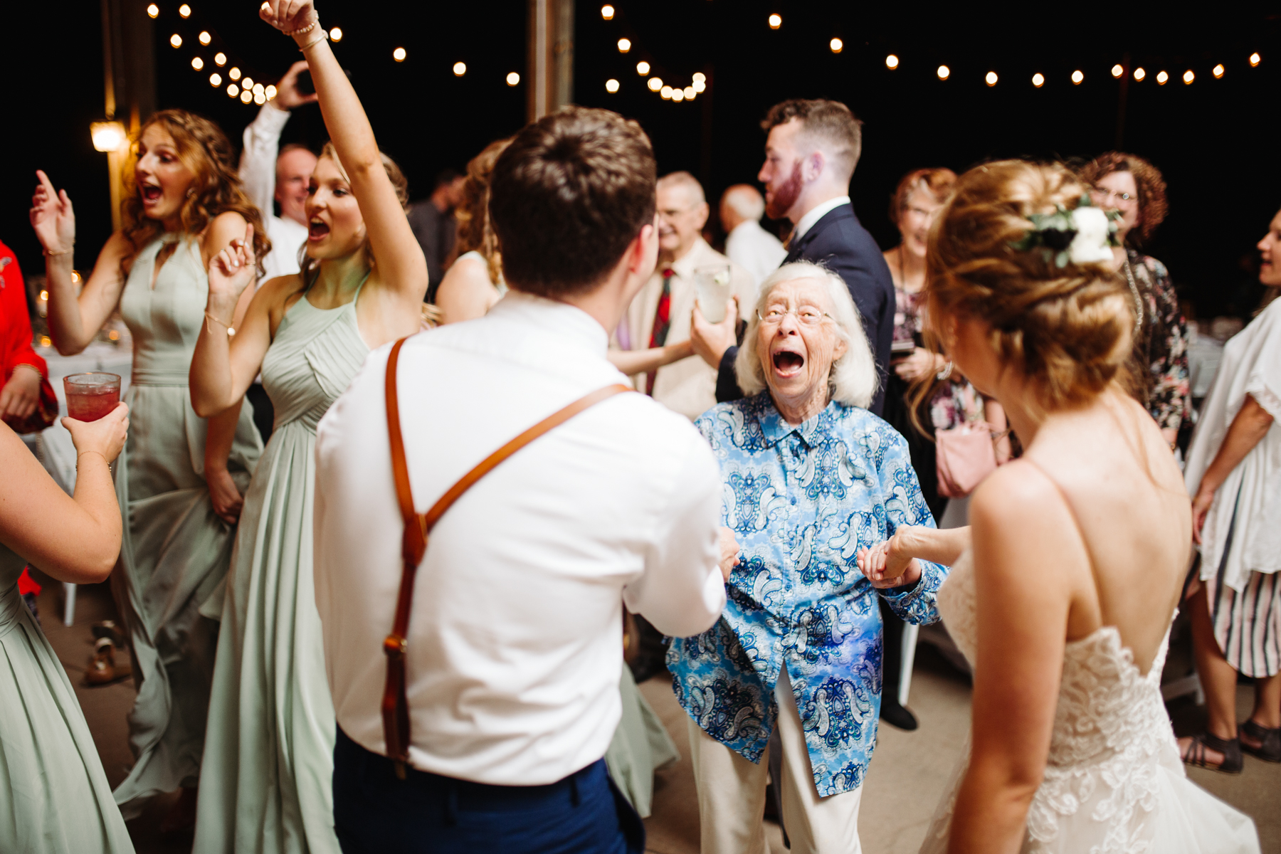 Grandmother of the bride dancing at a stables at strawberry creek wedding in knoxville, tennessee