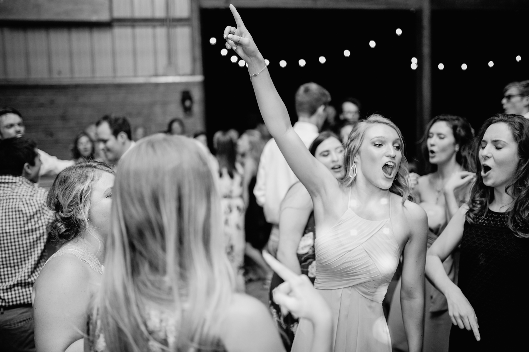 black and white dance floor photos at a stables at strawberry creek wedding in knoxville, tennessee