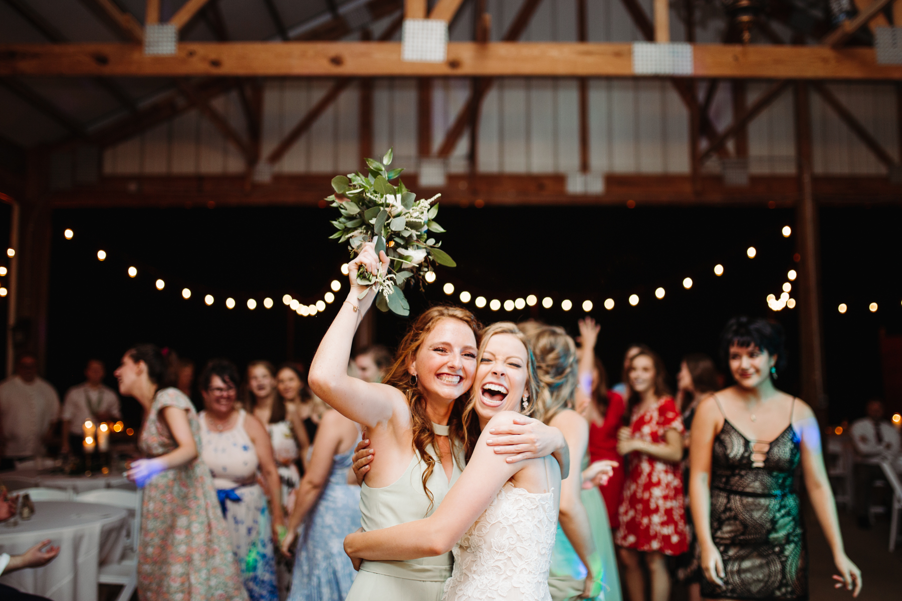 Winner of the bouquet toss at a stables at strawberry creek wedding in knoxville, tennessee