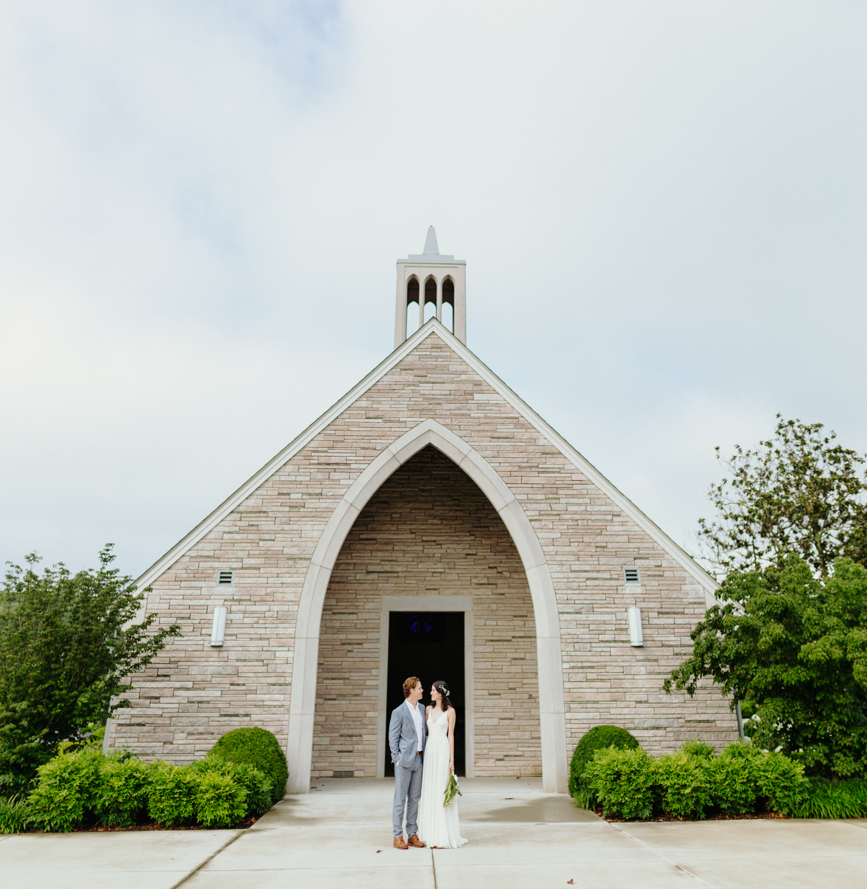bride and groom in front of Lakeshore Chapel before a downtown knoxville wedding at redeemer church