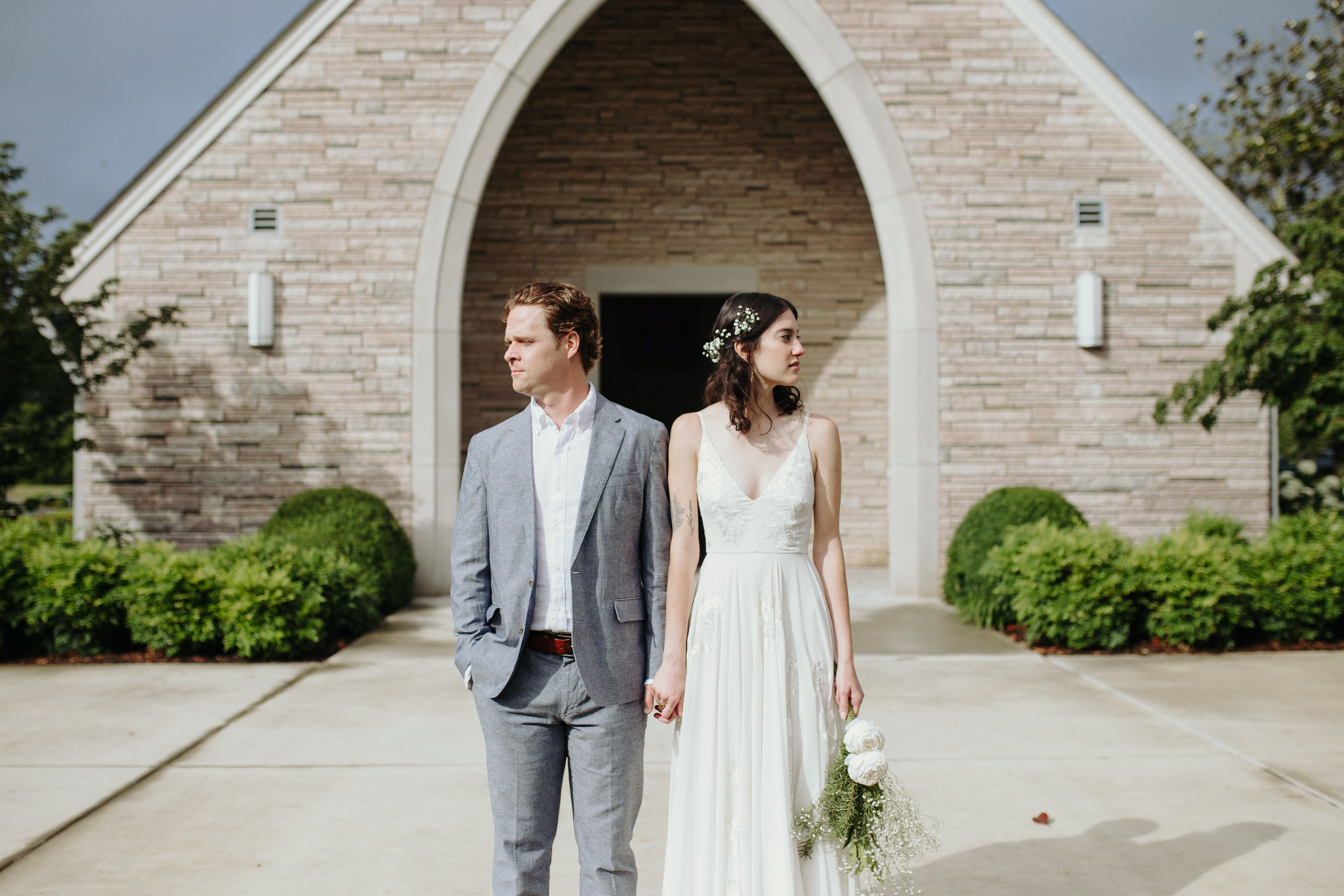 Bride and groom outside of lakeshore chapel before their downtown knoxville wedding at redeemer church