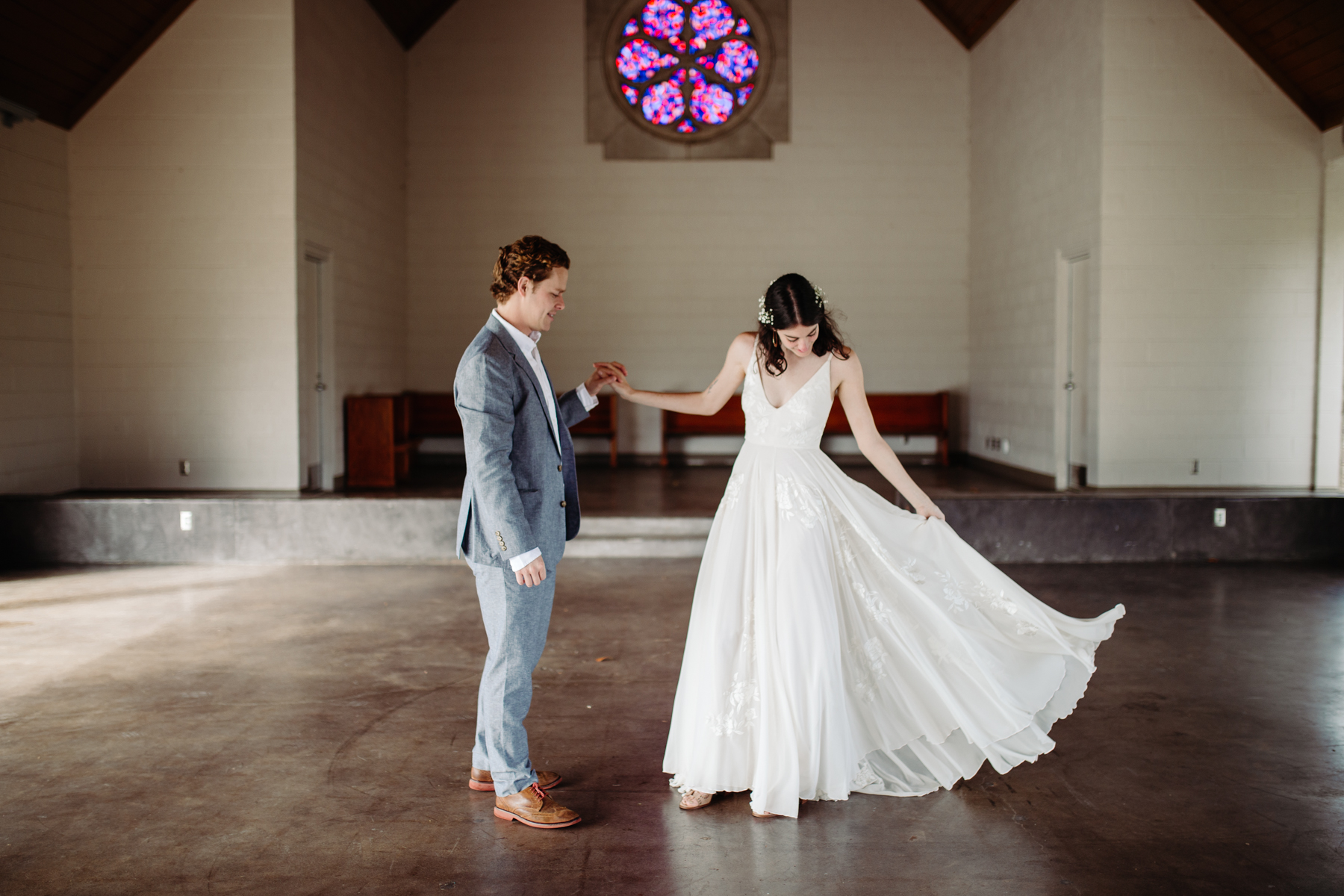 Bride spins her dress inside Lakeshore chapel before her downtown knoxville wedding at redeemer church