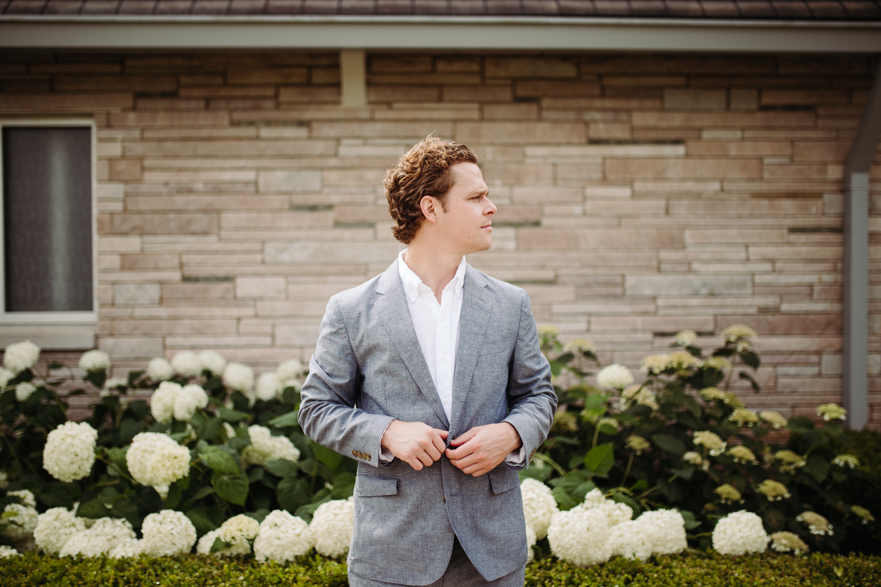Groom's portraits outside of Lakeshore Chapel before his downtown knoxville wedding at redeemer church