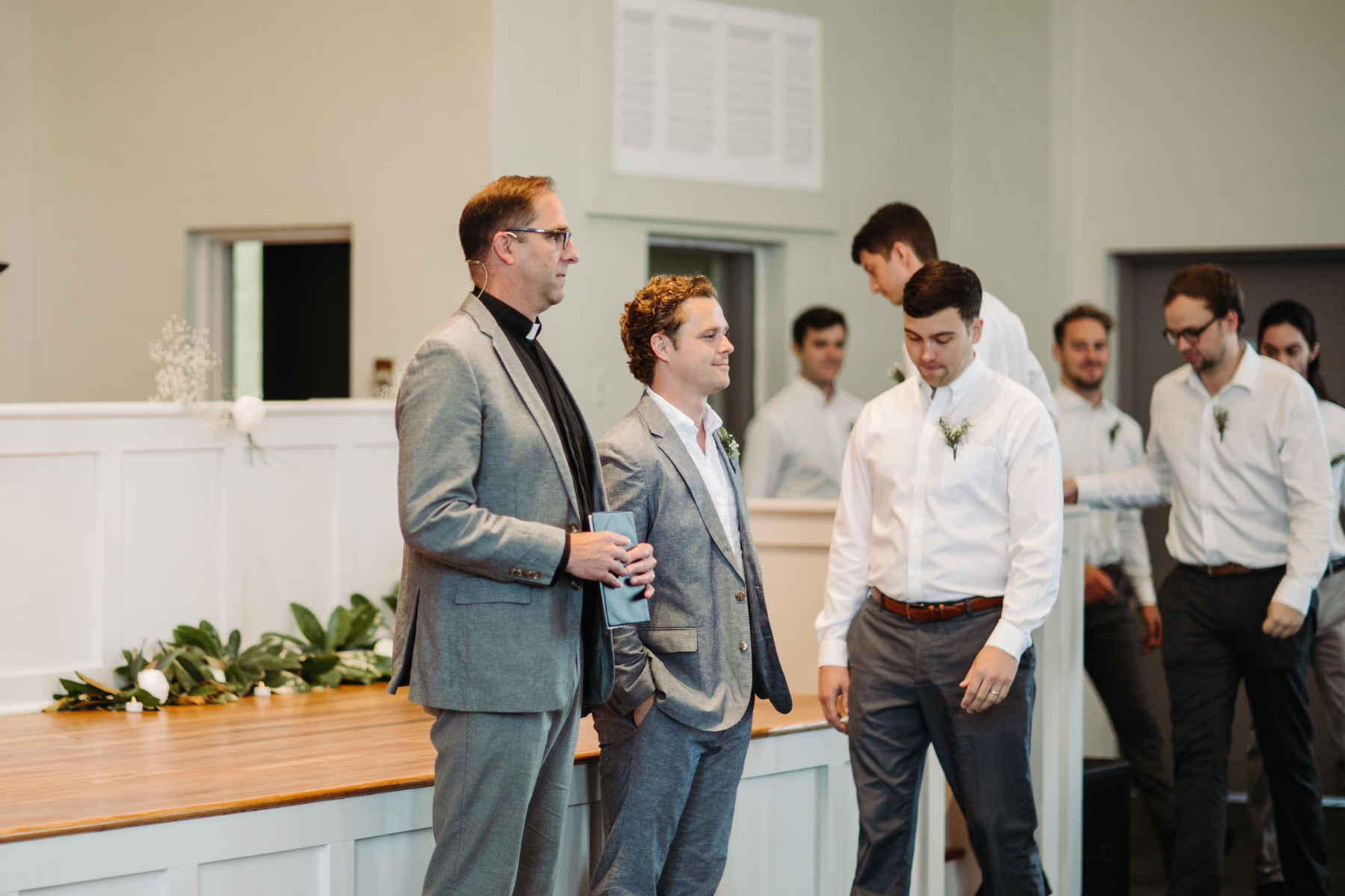 Groom watching his bride come down the aisle at a downtown knoxville wedding at redeemer church