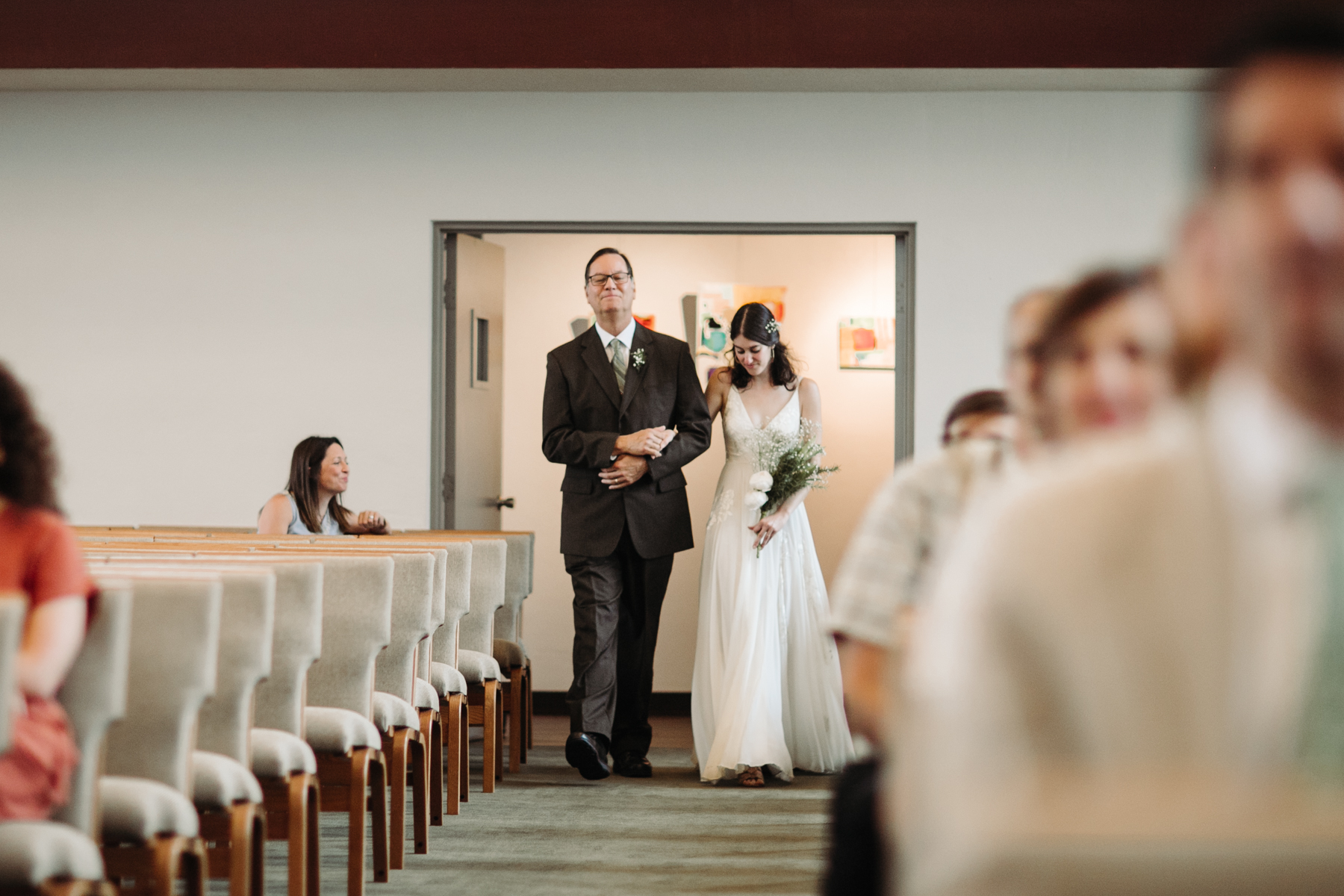 Father and daughter walking down the aisle at a downtown knoxville wedding at redeemer church